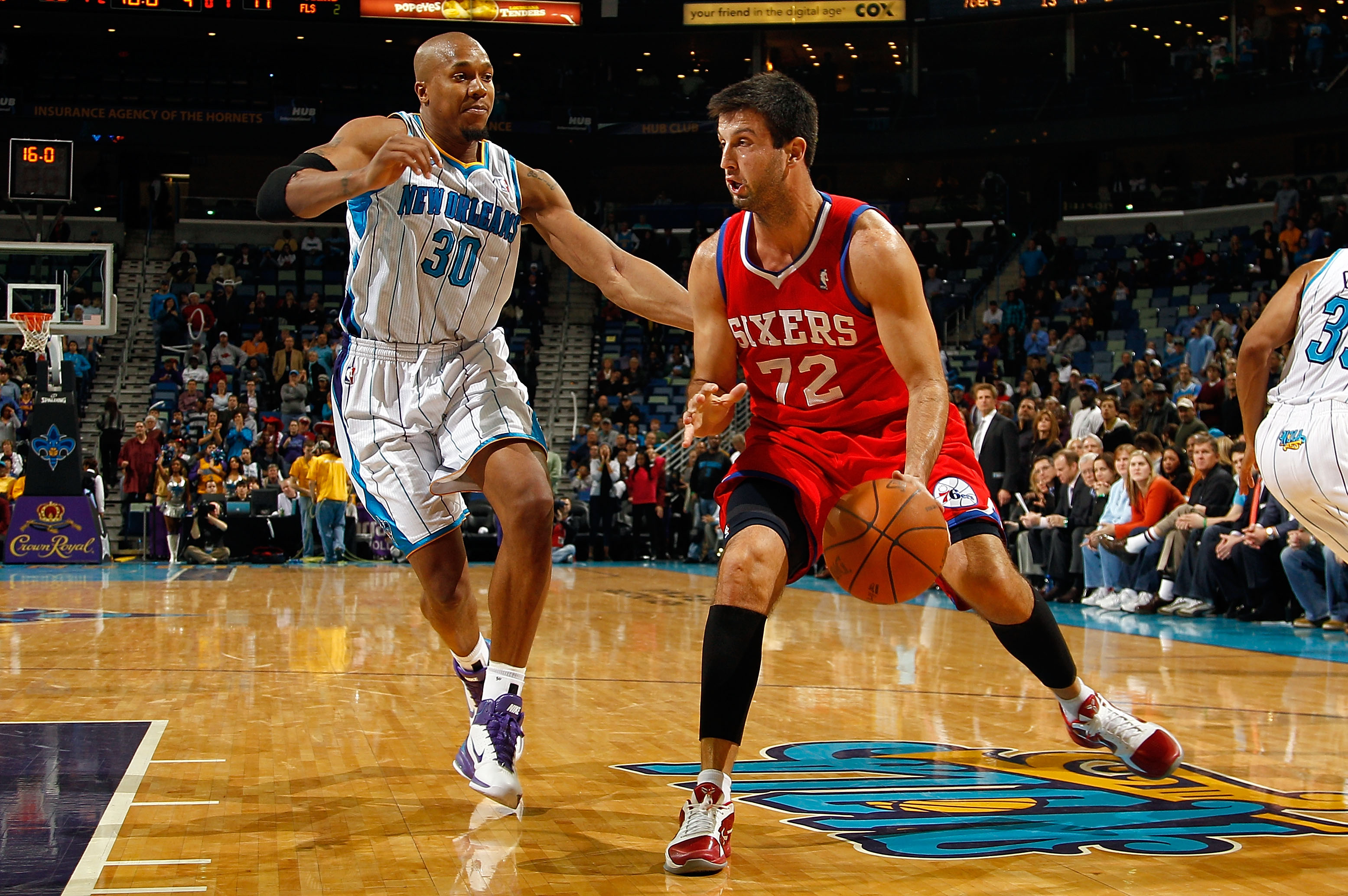 NEW ORLEANS, LA - JANUARY 03:  Jason Kapono #72 of the Philadelphia 76ers moves the ball against David West #30 of the New Orleans Hornets at New Orleans Arena on January 3, 2011 in New Orleans, Louisiana. NOTE TO USER: User expressly acknowledges and agr