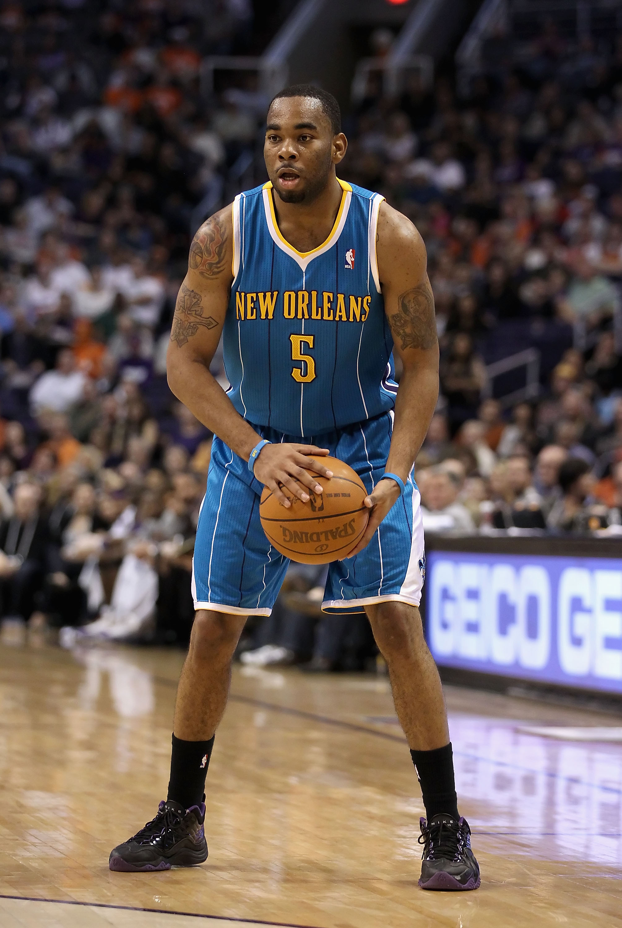 PHOENIX, AZ - JANUARY 30:  Marcus Thornton #5 of the New Orleans Hornets handles the ball during the NBA game against  the Phoenix Suns at US Airways Center on January 30, 2011 in Phoenix, Arizona.  The Suns defeated the Hornets 104-102. NOTE TO USER: Use