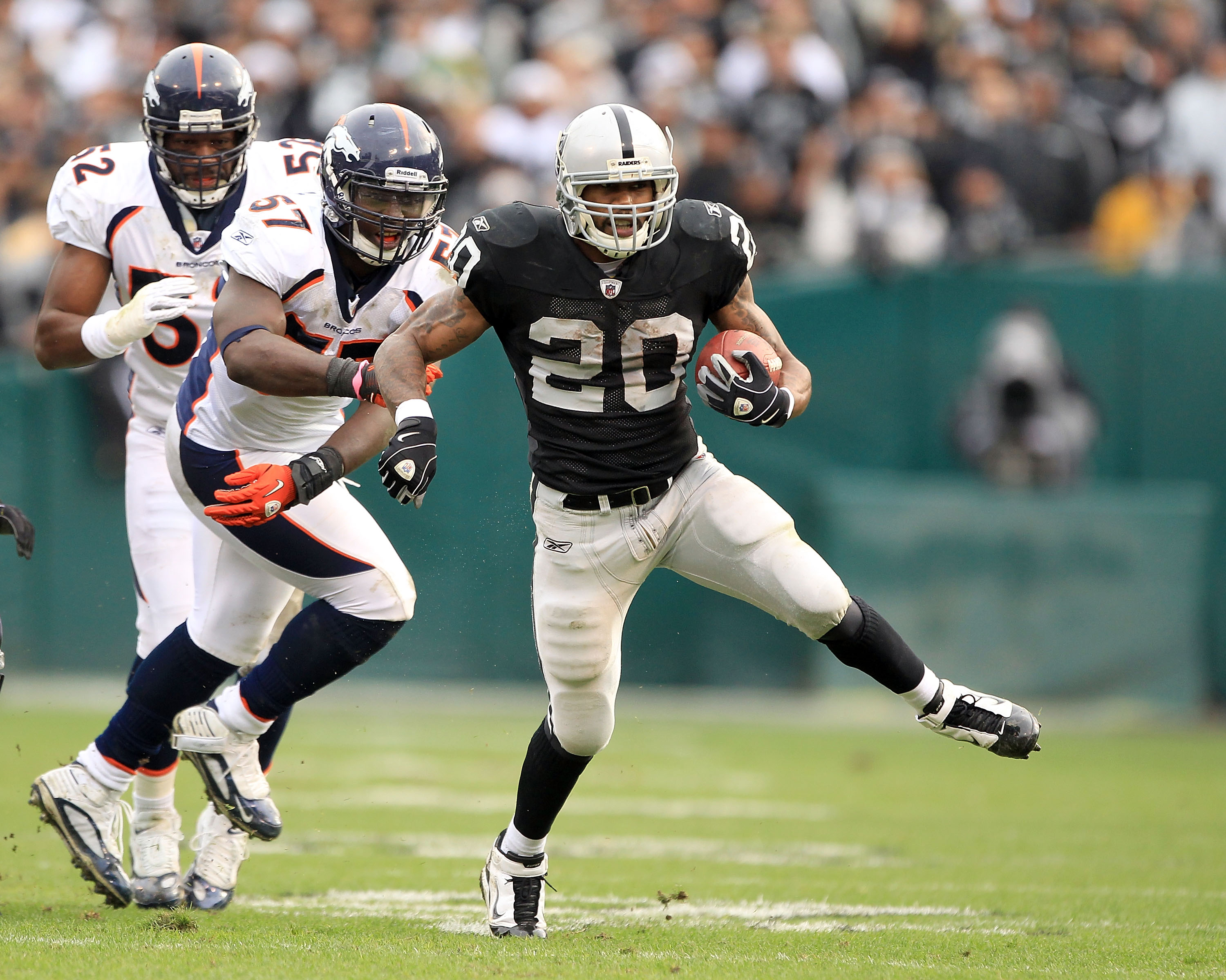 OAKLAND, CA - DECEMBER 19:  Darren McFadden #20 of the Oakland Raiders runs with the ball during their game against the Denver Broncos at Oakland-Alameda County Coliseum on December 19, 2010 in Oakland, California.  (Photo by Ezra Shaw/Getty Images)