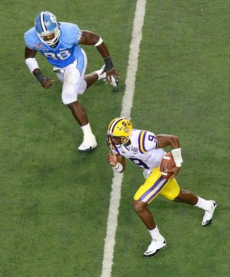 ATLANTA - SEPTEMBER 04:  Quarterback Jordan Jefferson #9 of the LSU Tigers against Donte Paige-Moss #98 of the North Carolina Tar Heels during the Chick-fil-A Kickoff Game at Georgia Dome on September 4, 2010 in Atlanta, Georgia.  (Photo by Kevin C. Cox/G