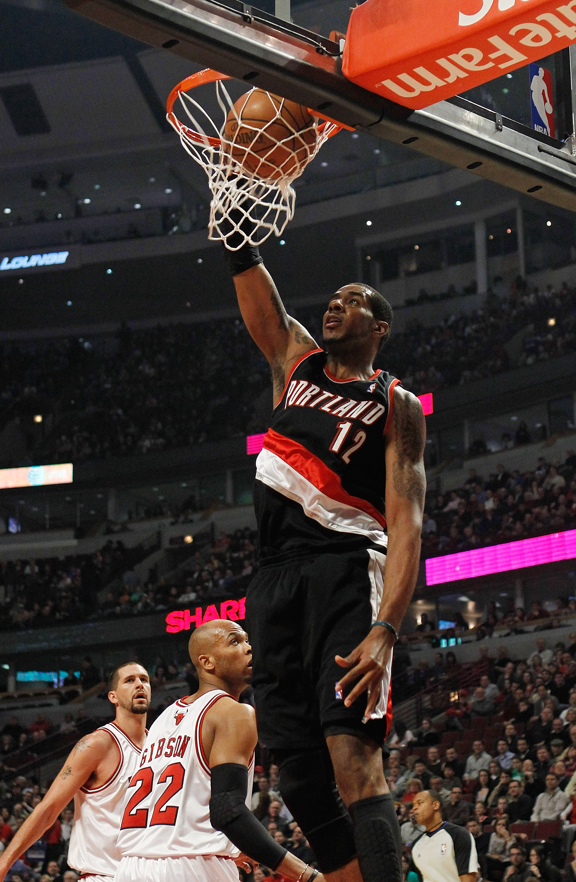 CHICAGO - FEBRUARY 26: LaMarcus Aldridge #12 of the Portland Trail Blazers dunks the ball against the Chicago Bulls at the United Center on February 26, 2010 in Chicago, Illinois. NOTE TO USER: User expressly acknowledges and agrees that, by downloading a