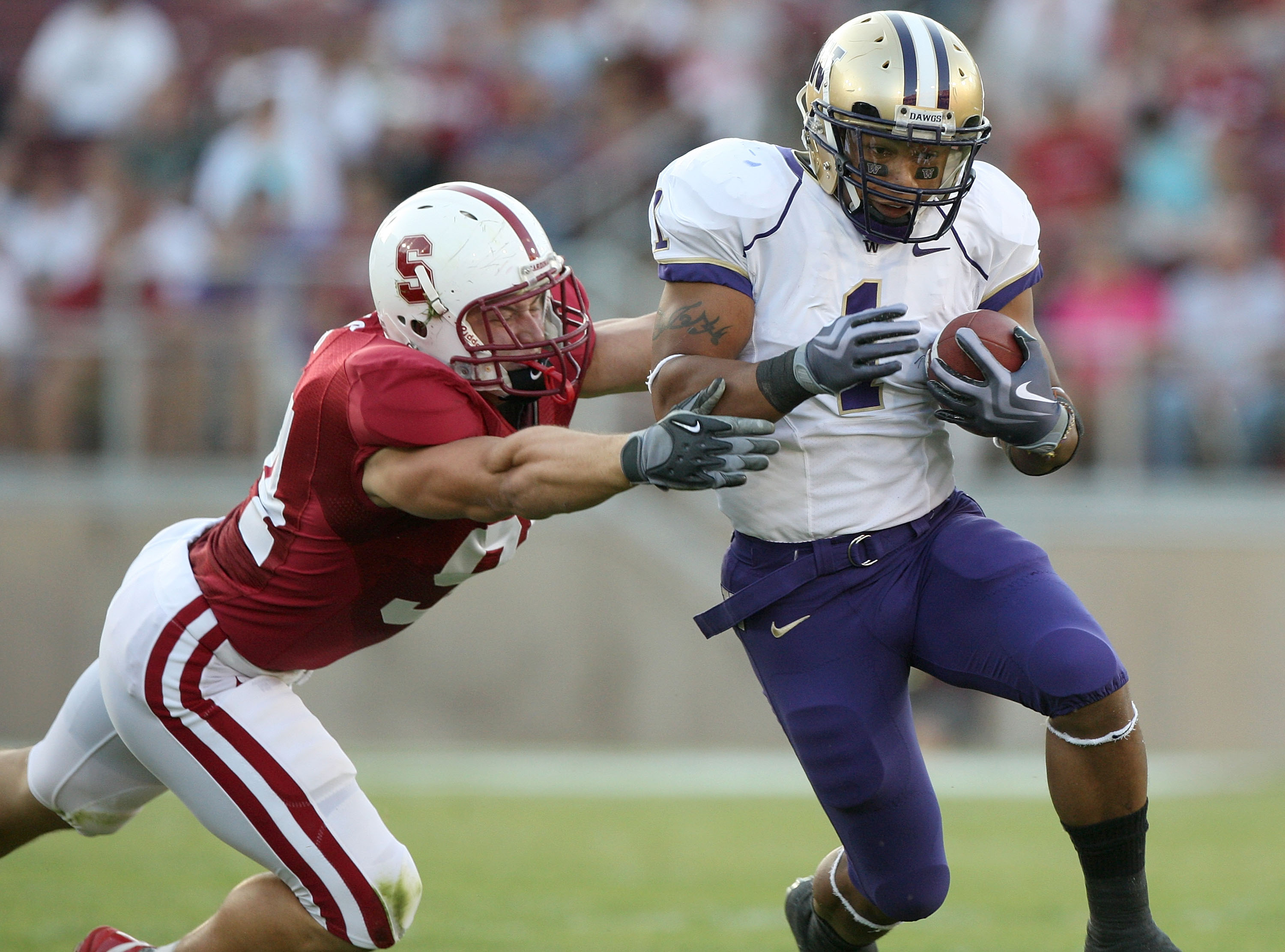 PALO ALTO, CA - SEPTEMBER 26:  Chris Polk #1 of the Washington Huskies runs against Thomas Keiser #94 of the Stanford Cardinal at Stanford Stadium on September 26, 2009 in Palo Alto, California.  (Photo by Jed Jacobsohn/Getty Images)