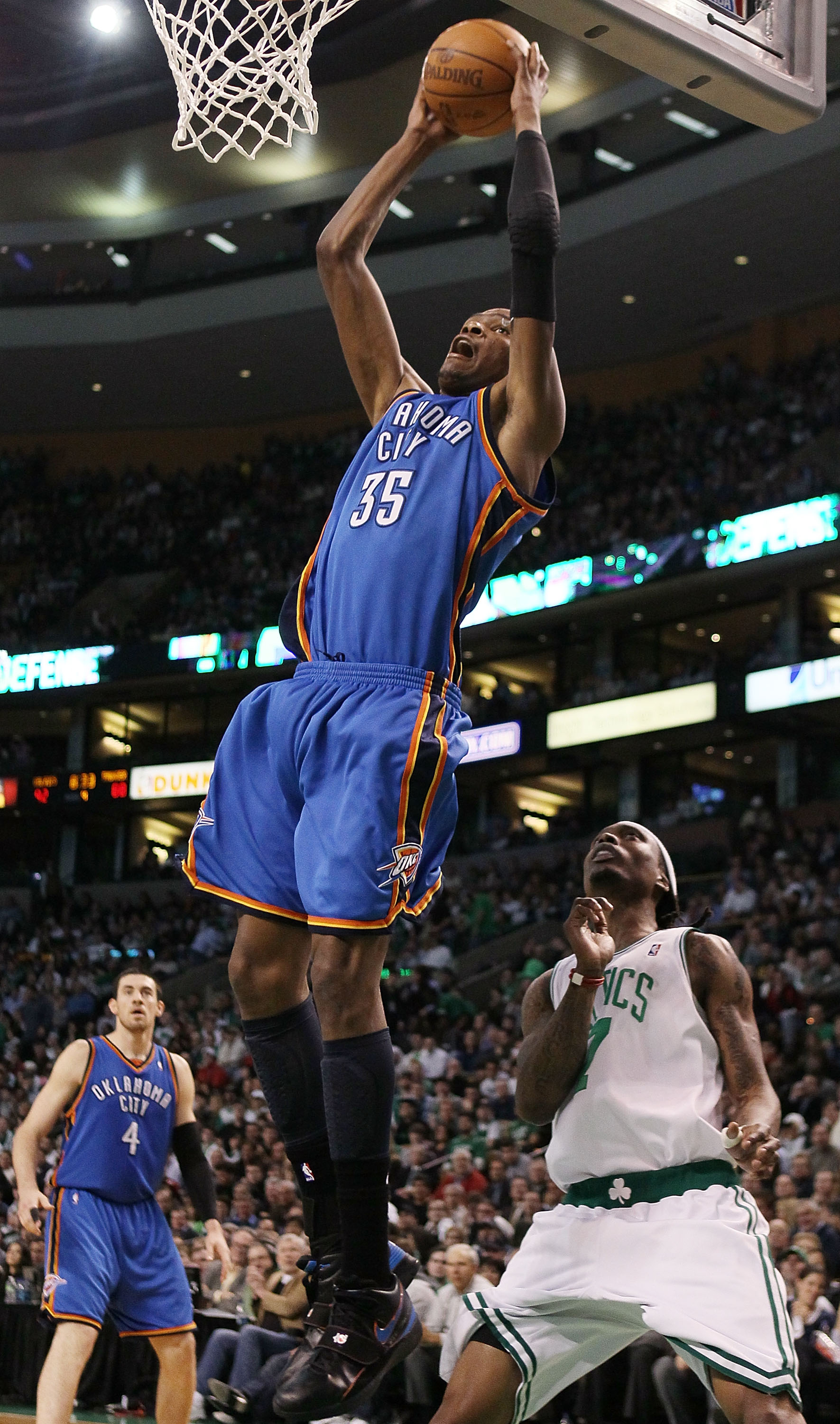 BOSTON - MARCH 31:  Kevin Durant #35 of the Oklahoma City Thunder goes in for the dunk as Marquis Daniels #7 of the Boston Celtics defends on March 31, 2010 at the TD Garden in Boston, Massachusetts. The Oklahoma City Thunder defeated the Boston Celtics 1