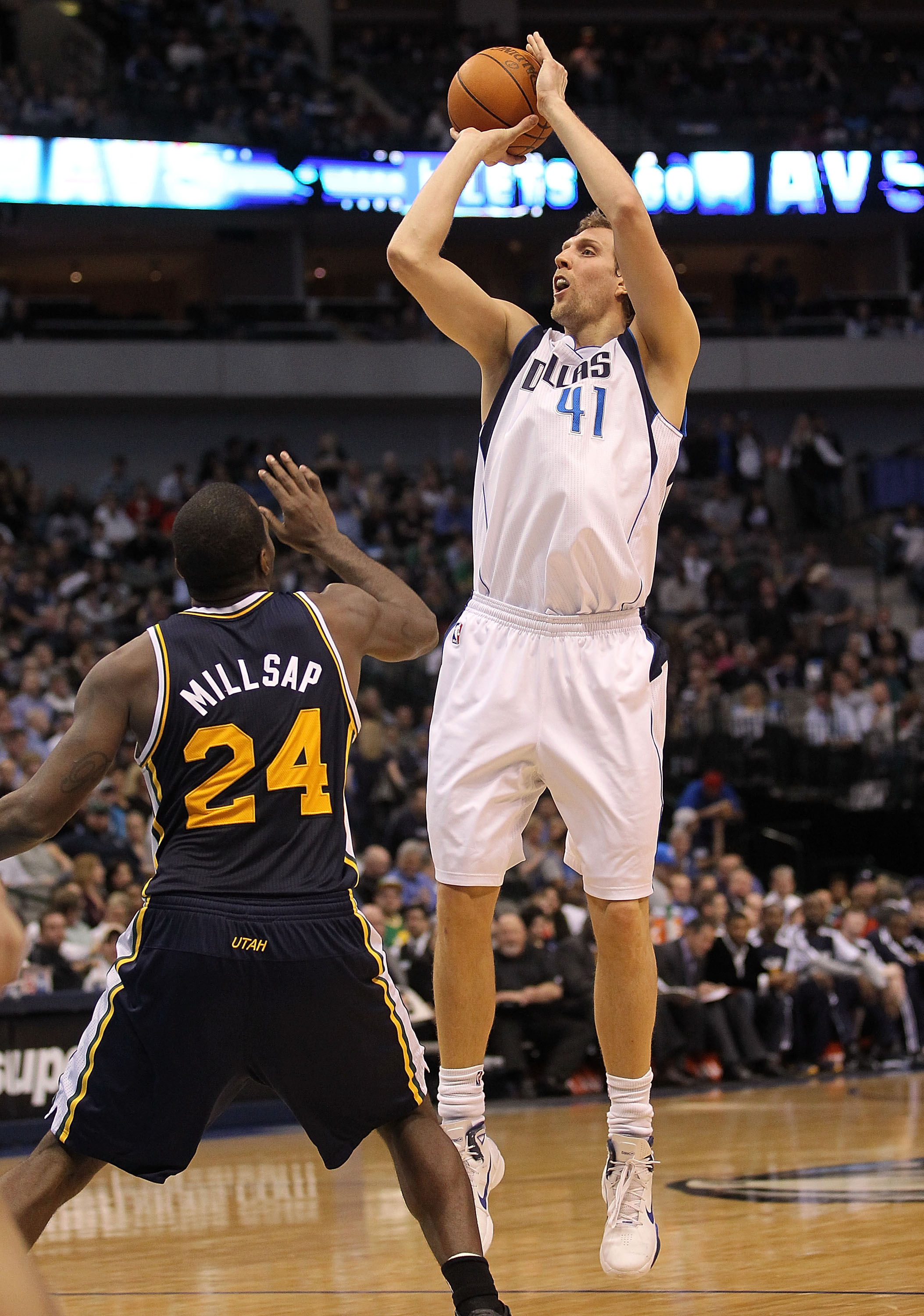 DALLAS, TX - FEBRUARY 23:  Forward Dirk Nowitzki #41 of the Dallas Mavericks takes a shot against Paul Millsap #24 of the Utah Jazz at American Airlines Center on February 23, 2011 in Dallas, Texas.  NOTE TO USER: User expressly acknowledges and agrees th
