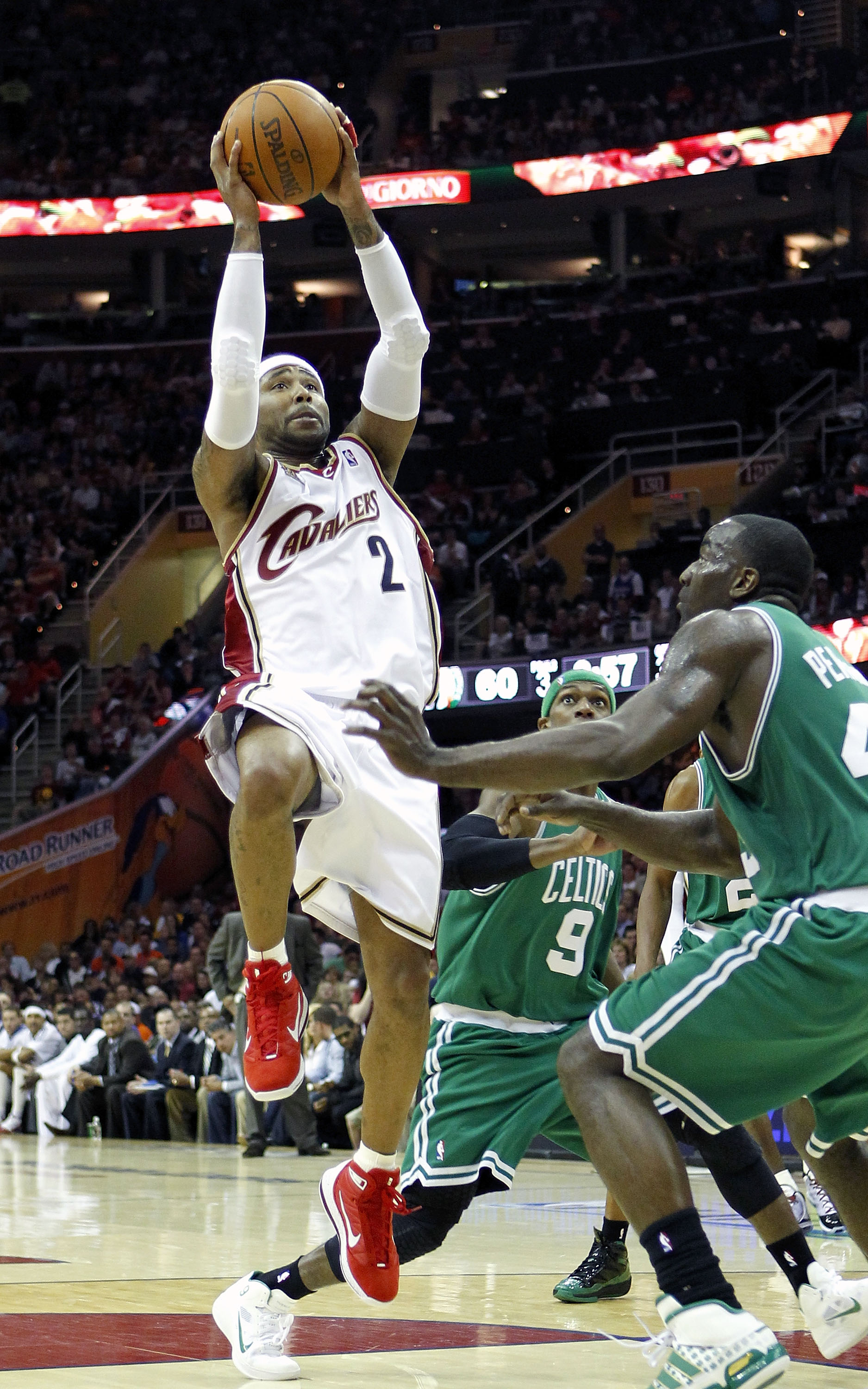 CLEVELAND - MAY 01:  Mo Williams #2 of the Cleveland Cavaliers gets a shot off over Kendrick Perkins #43 of the Boston Celtics during Game One of the Eastern Conference Semifinals during the 2010 NBA Playoffs at Quicken Loans Arena on May 1, 2010 in Cleve