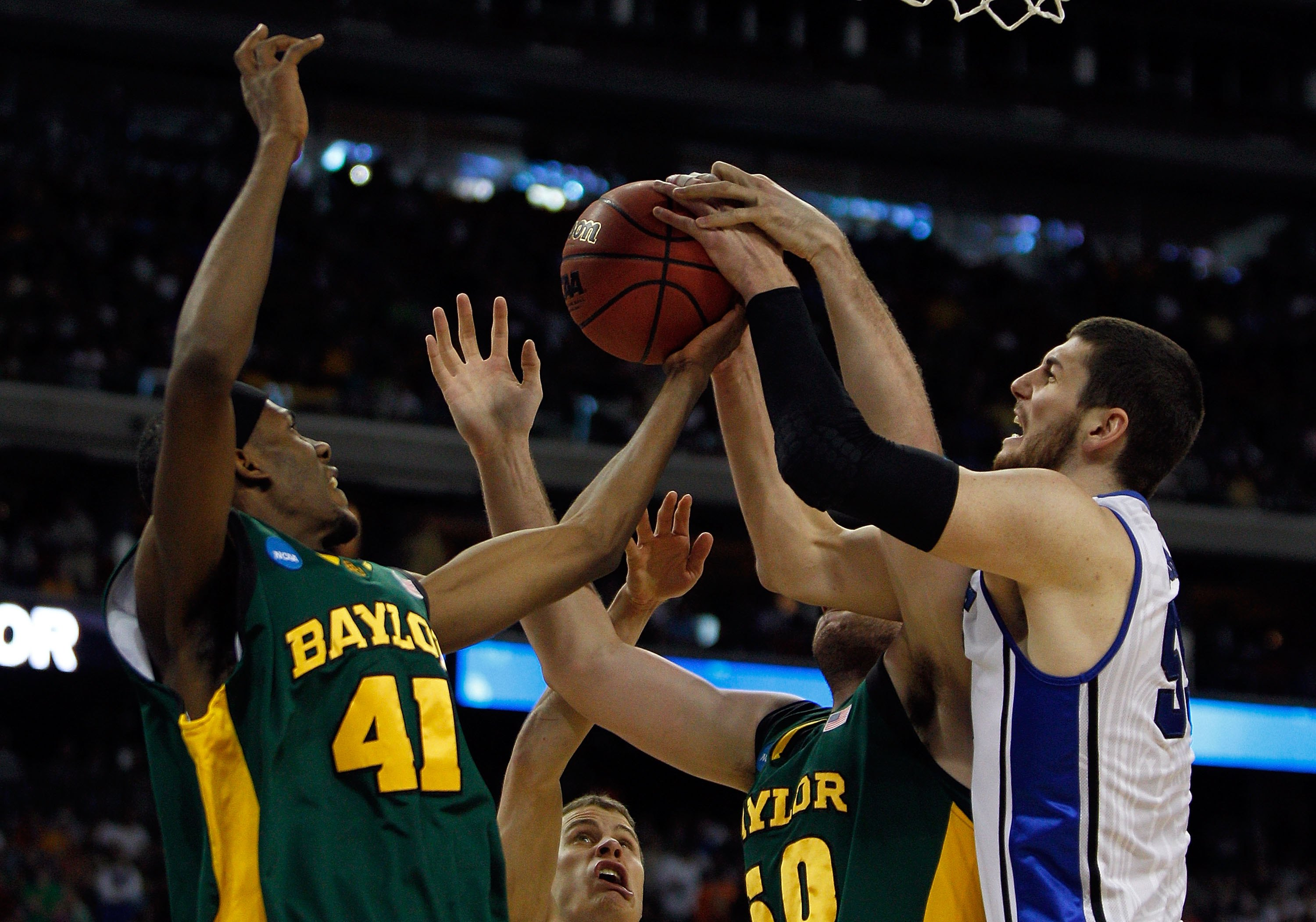 HOUSTON - MARCH 28: Brian Zoubek #55 of the Duke Blue Devils grabs a rebound from Anthony Jones #41 and Josh Lomers #50 of the Baylor Bears during the south regional final of the 2010 NCAA men's basketball tournament at Reliant Stadium on March 28, 2010 i