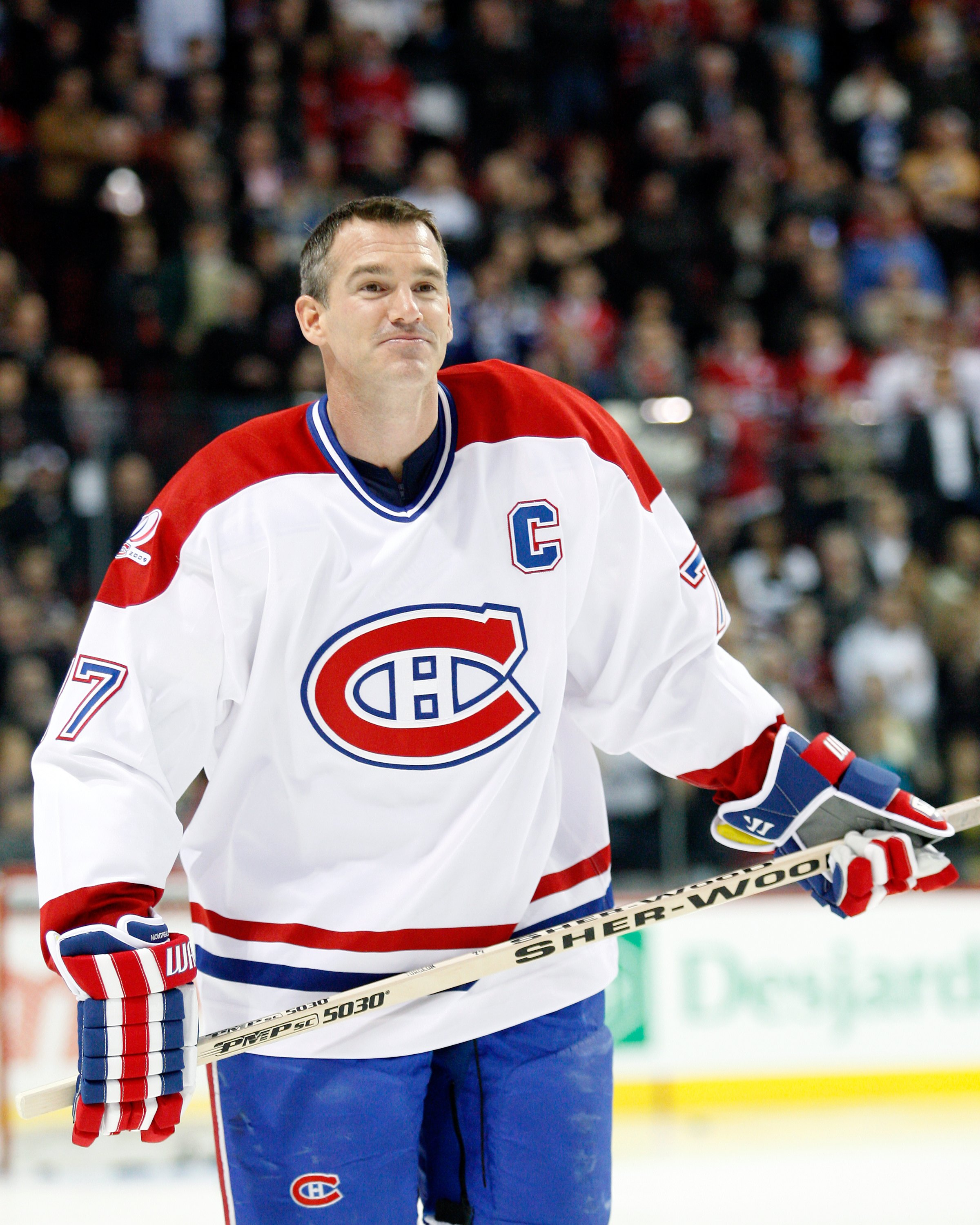 iMONTREAL- DECEMBER 4:  Former Montreal Canadien Pierre Turgeon skates during the Centennial Celebration ceremonies prior to the NHL game between the Montreal Canadiens and Boston Bruins on December 4, 2009 at the Bell Centre in Montreal, Quebec, Canada.