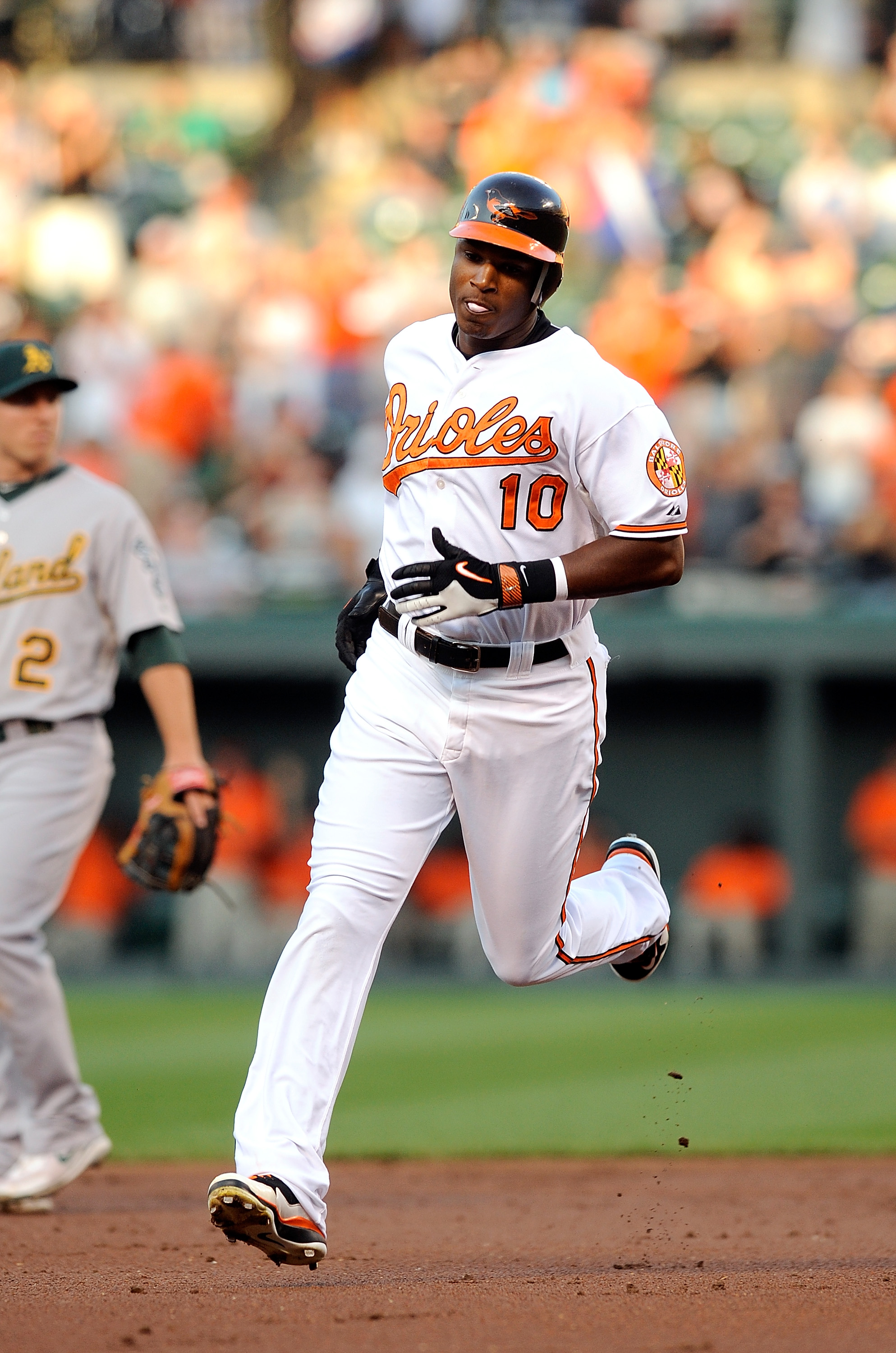 BALTIMORE - JUNE 30:  Adam Jones #10 of the Baltimore Orioles rounds the bases after hitting a home run in the second inning against the Oakland Athletics at Camden Yards on June 30, 2010 in Baltimore, Maryland.  (Photo by Greg Fiume/Getty Images)