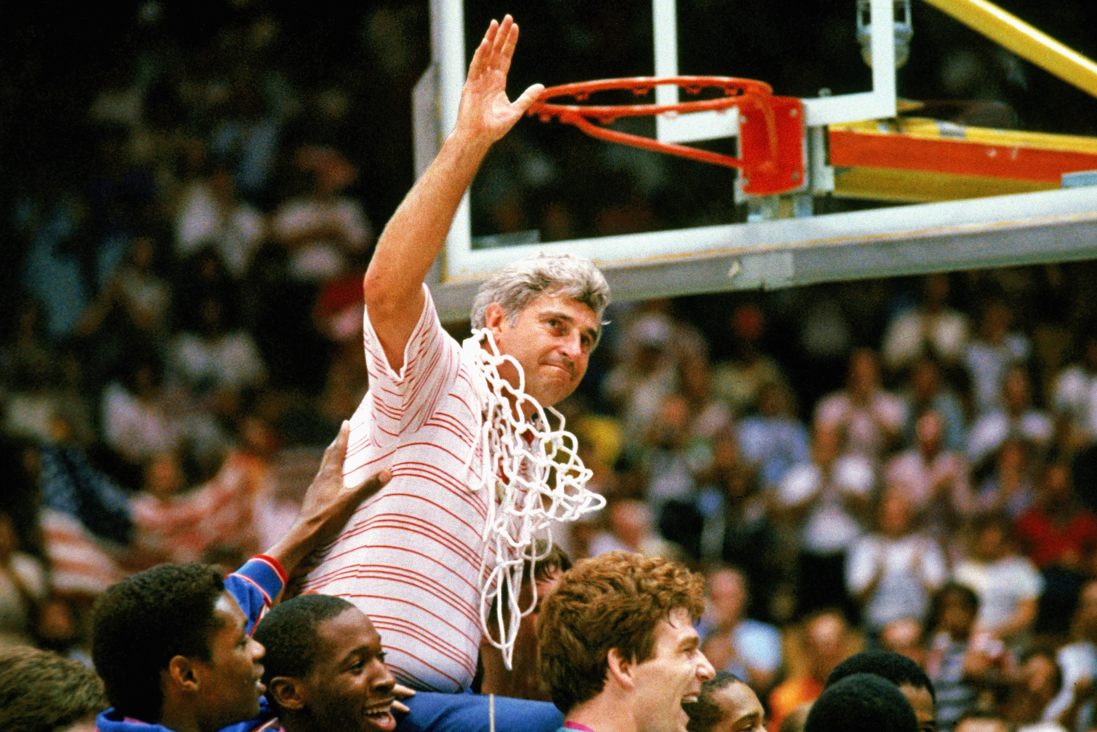 UNDATED: Bobby Knight coach for Indiana University mens basketball cuts down the nets to celebrate a big victory. (Photo by Getty Images)