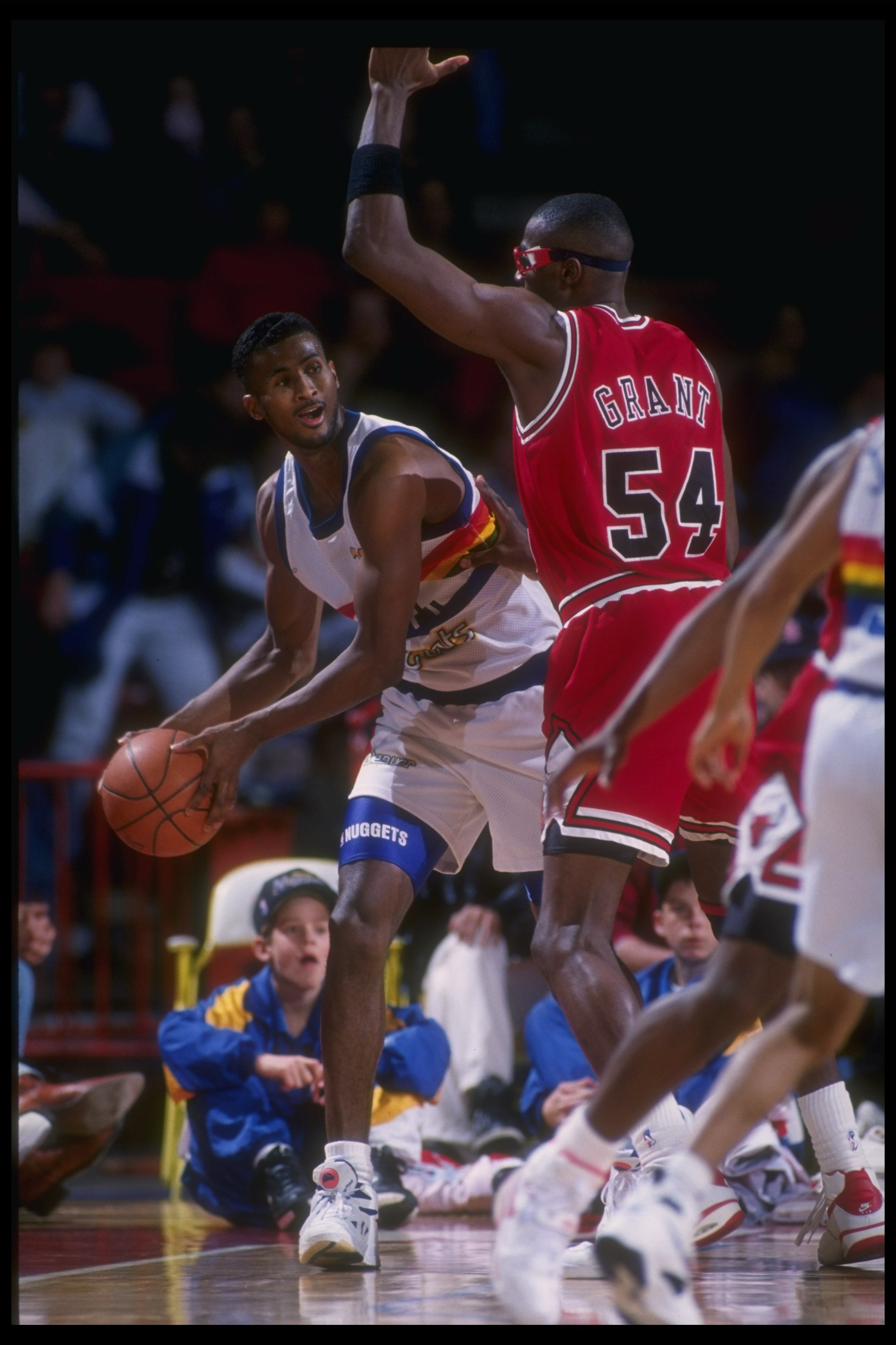 1992-1993:  Forward Marcus Liberty of the Denver Nuggets looks to pass the ball around forward Horace Grant of the Chicago Bulls during a game against the Chicago Bulls at McNichols Arena in Denver, Colorado. Mandatory Credit: Tim DeFrisco  /Allsport Mand