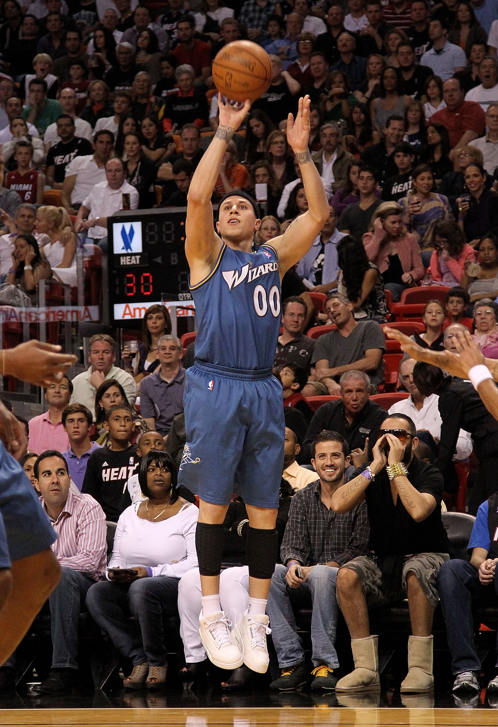 MIAMI, FL - FEBRUARY 25:  Mike Bibby #00 of the  Washington Wizards shoots a jump shot during a game against the Miami Heat  at American Airlines Arena on February 25, 2011 in Miami, Florida. NOTE TO USER: User expressly acknowledges and agrees that, by d