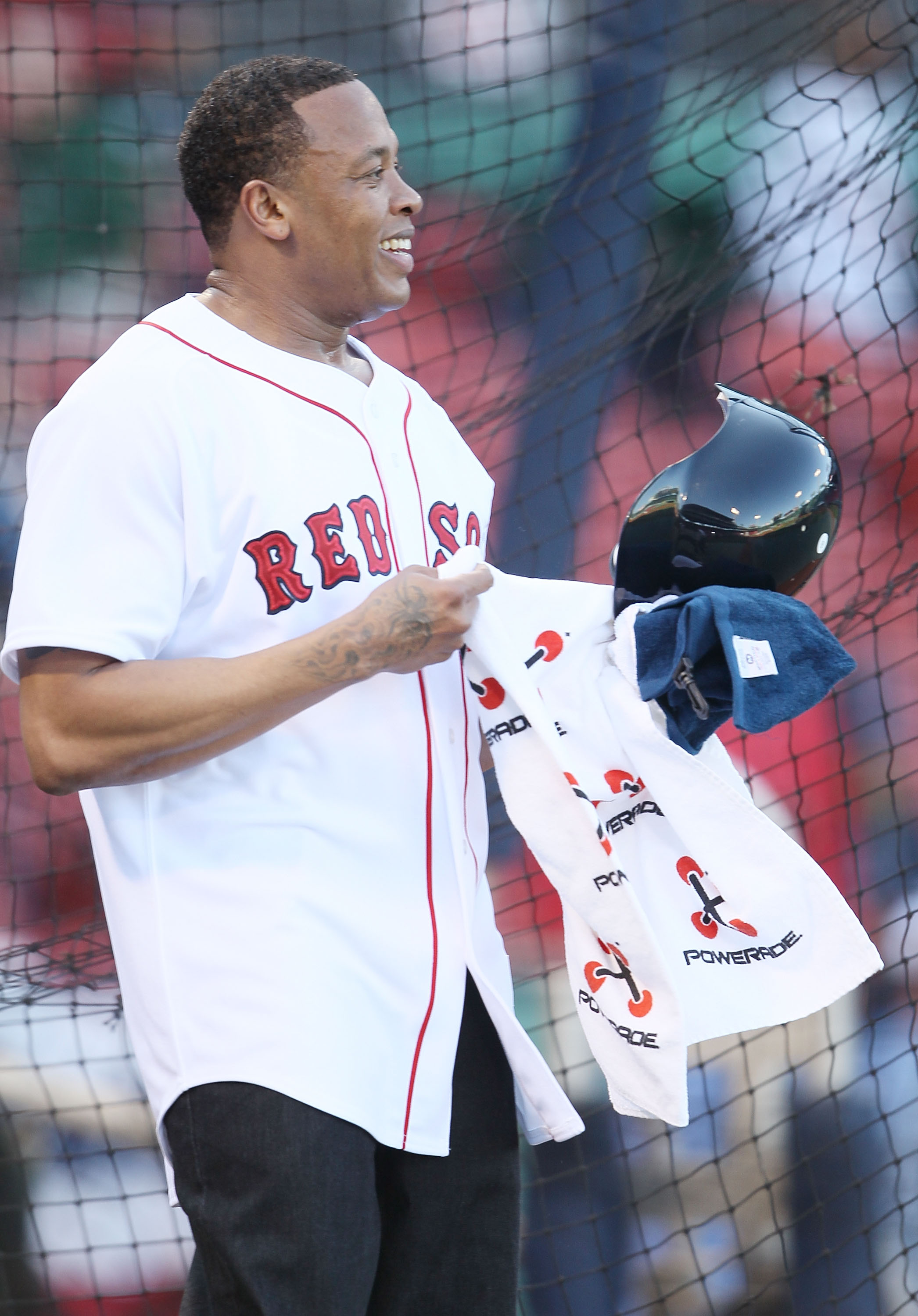 BOSTON - APRIL 04:  Producer and musician Dr. Dre takes batting practice before the Boston Red Sox  take on the the New York Yankees on April 4, 2010 during Opening Night at Fenway Park in Boston, Massachusetts. Dre was in to promote the Boston Red Sox ve