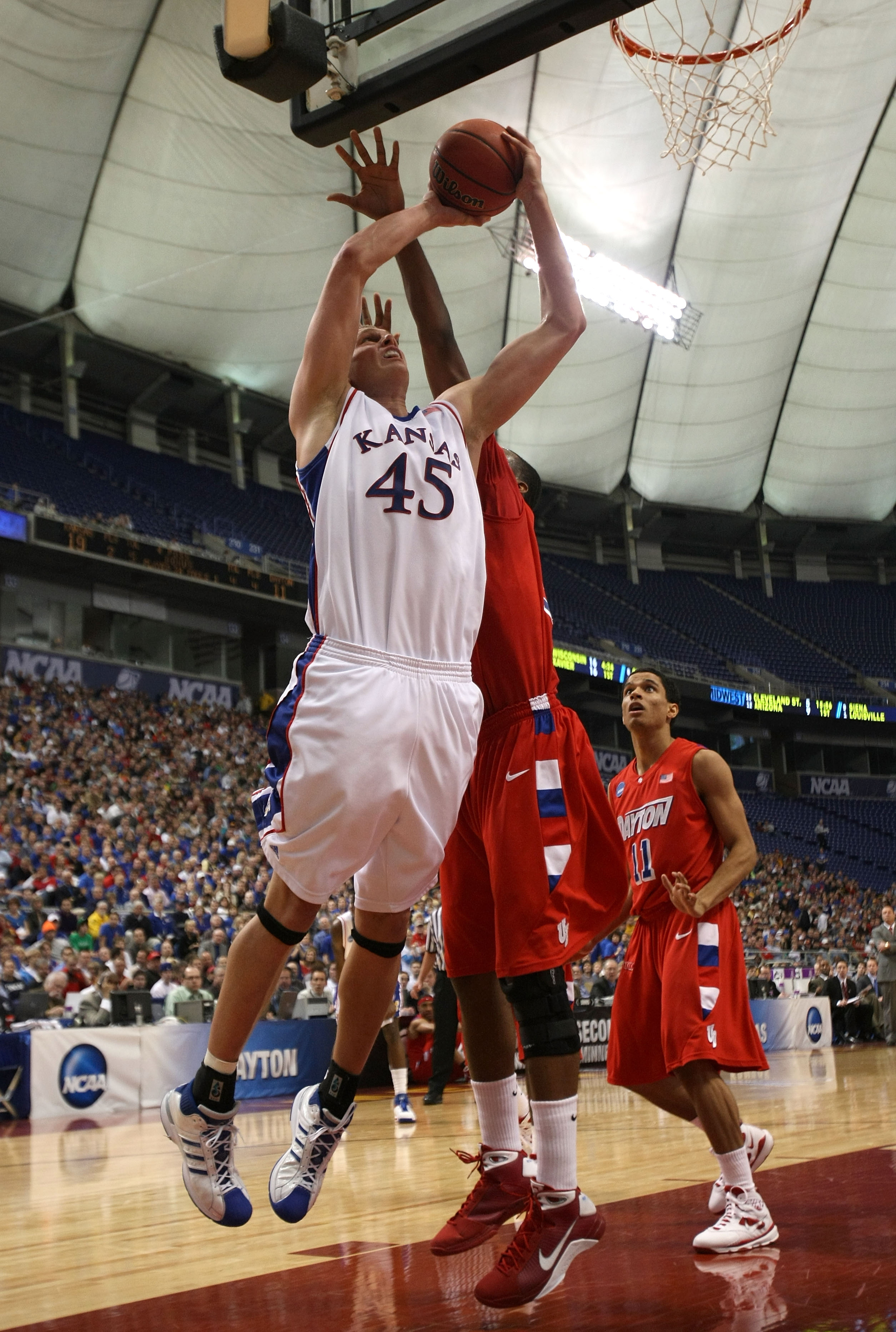 MINNEAPOLIS - MARCH 22:  Cole Aldrich #45 of the Kansas Jayhawks goes up for a shot attempt in the first half against the Dayton Flyers during the second round of the NCAA Division I Men's Basketball Tournament at the Hubert H. Humphrey Metrodome on March