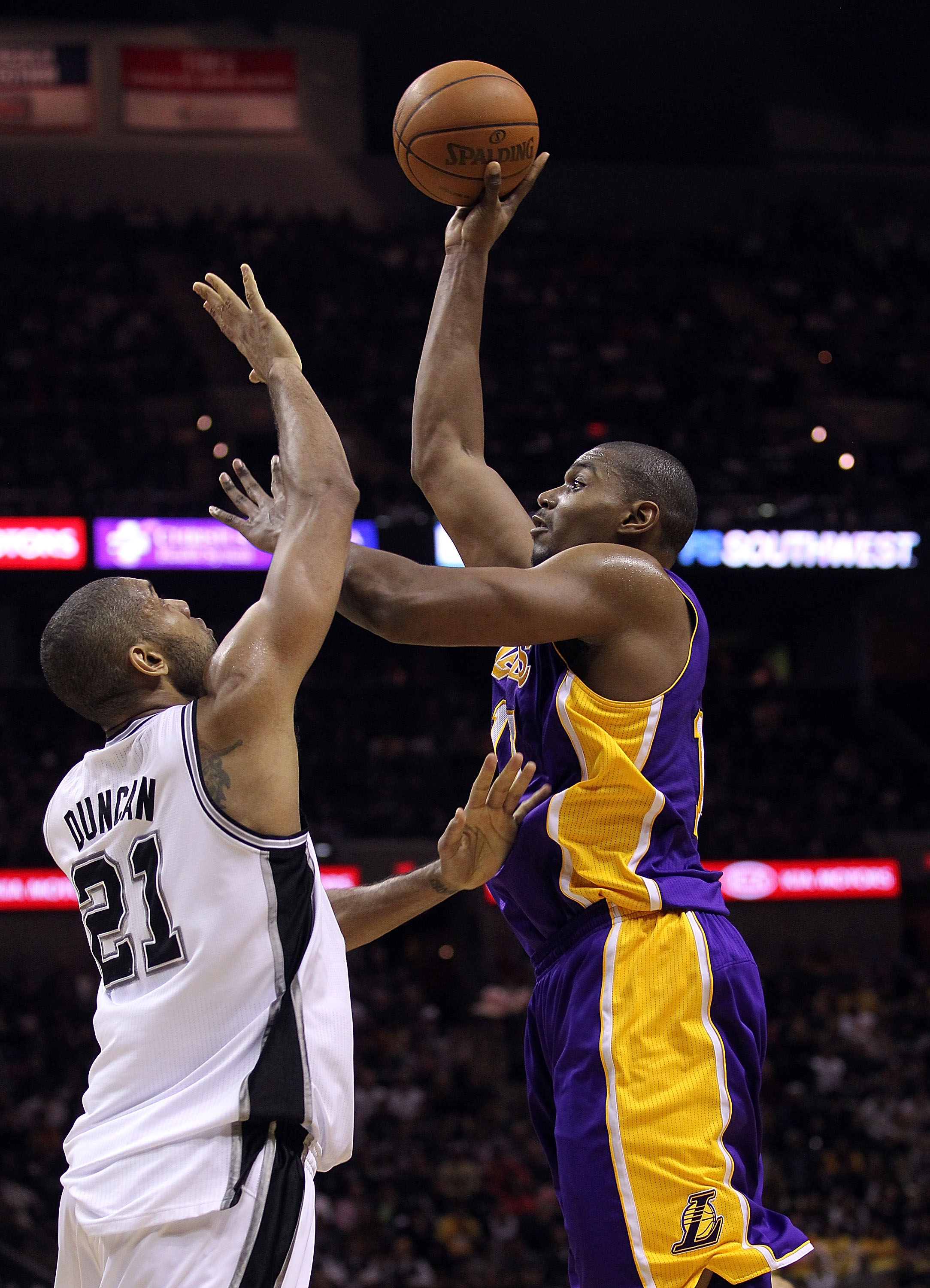 SAN ANTONIO, TX - DECEMBER 28:  Center Andrew Bynum #17 of the Los Angeles Lakers takes a shot against Tim Duncan #21 of the San Antonio Spurs at AT&T Center on December 28, 2010 in San Antonio, Texas.  NOTE TO USER: User expressly acknowledges and agrees