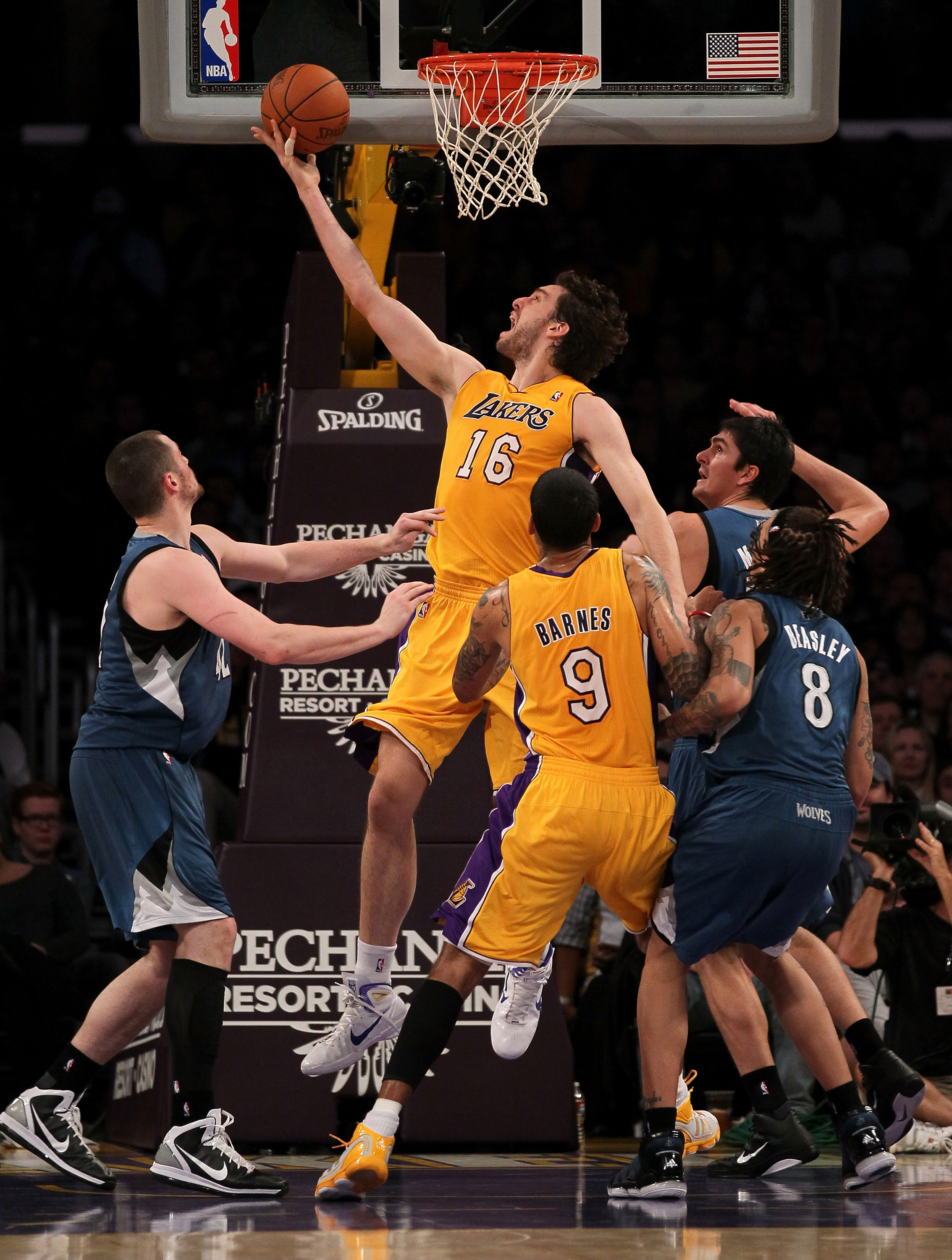 LOS ANGELES, CA - NOVEMBER 09:  Pau Gasol #16 of the Los Angeles Lakers shoots between Darko Milicic #31 and Kevin Love #42 of the Minnesota Timberwolves at Staples Center on November 9, 2010 in Los Angeles, California.   NOTE TO USER: User expressly ackn
