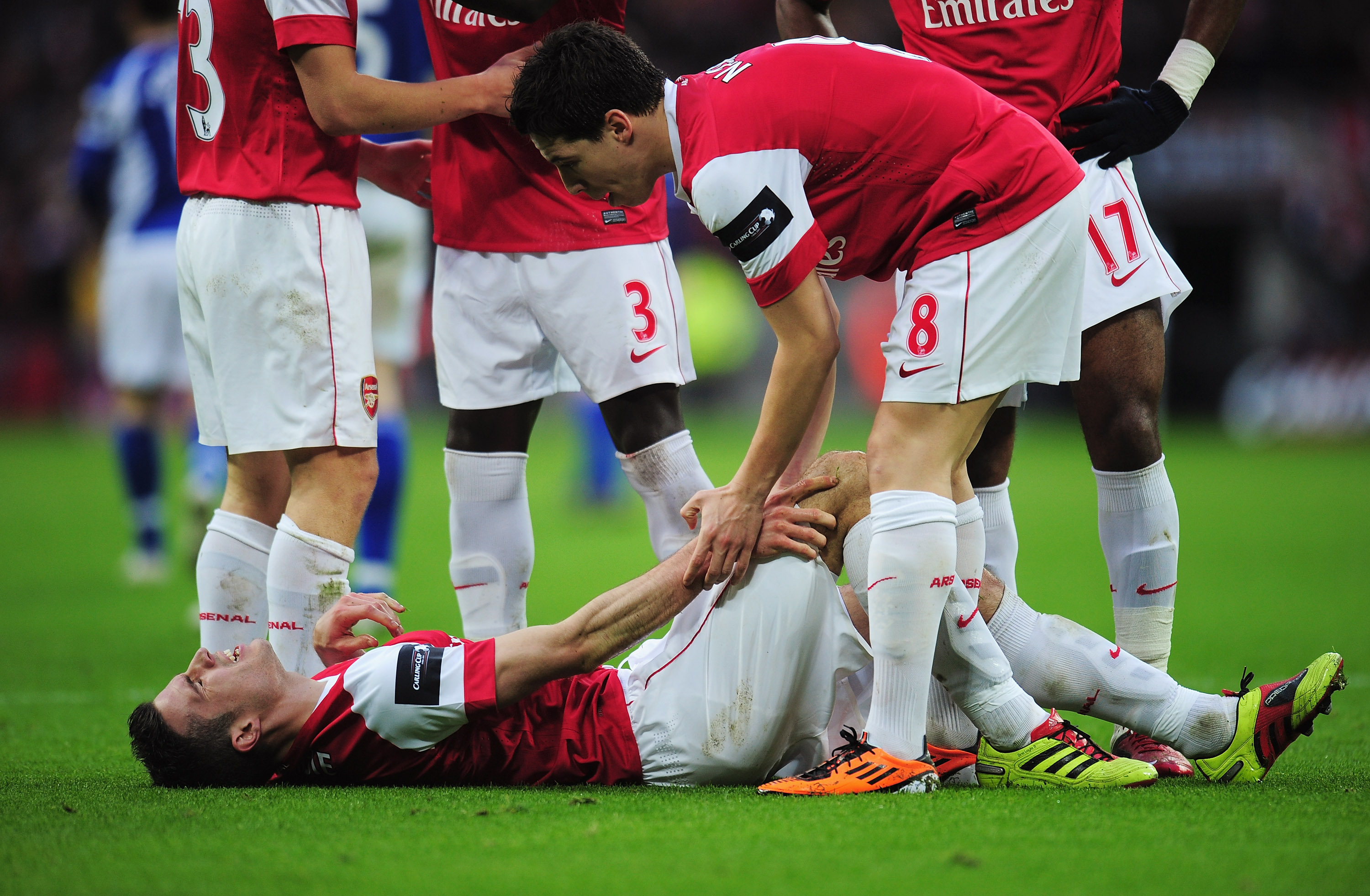 LONDON, ENGLAND - FEBRUARY 27: Robin van Persie of Arsenal lies on the ground as he is spoken to by Samir Nasri during the Carling Cup Final between Arsenal and Birmingham City at Wembley Stadium on February 27, 2011 in London, England.  (Photo by Shaun B