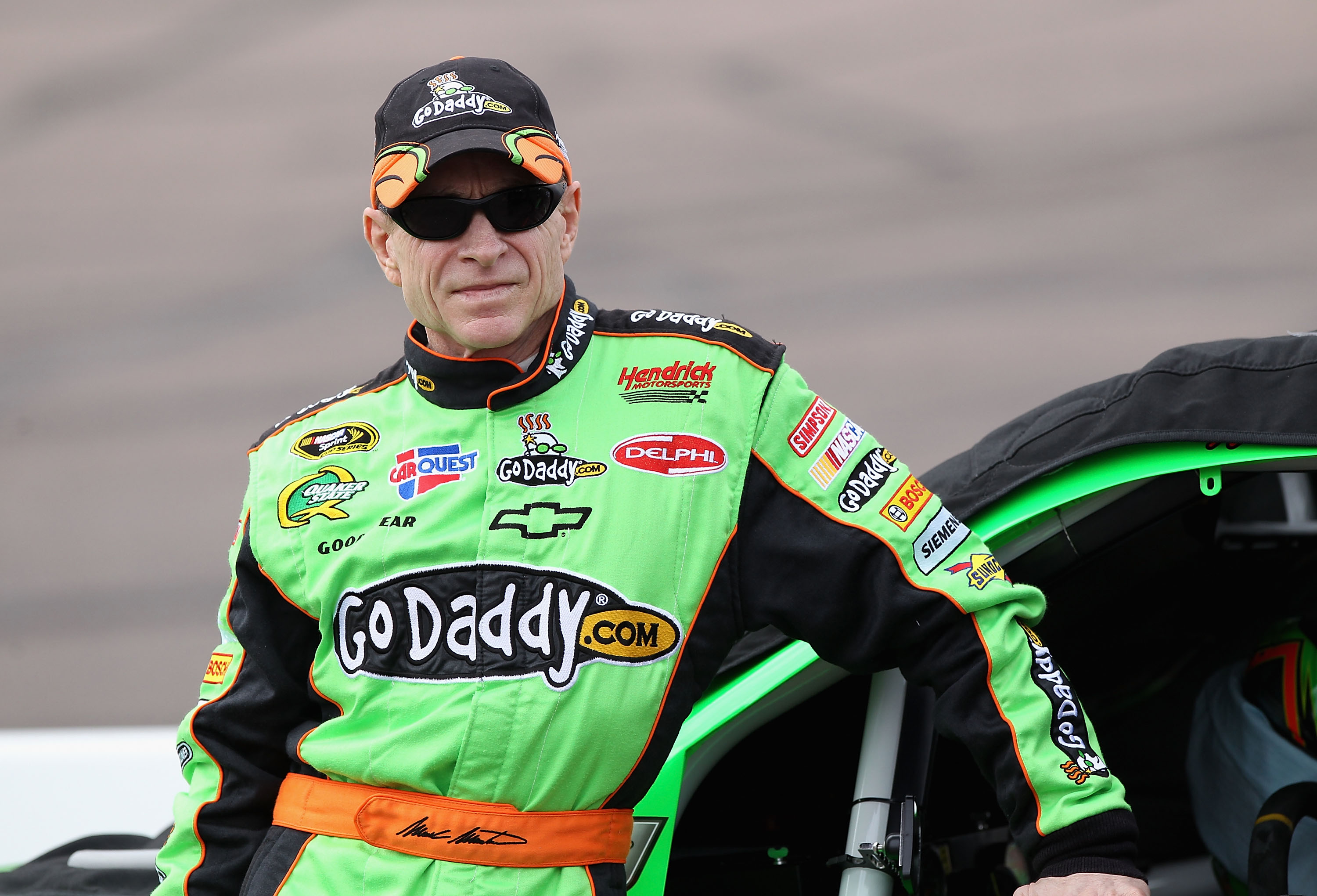 AVONDALE, AZ - FEBRUARY 26:  Mark Martin, driver of the #5 GoDaddy.com Chevrolet, stands on pit road during qualifying for the NASCAR Sprint Cup Series Subway Fresh Fit 500 at Phoenix International Raceway on February 26, 2011 in Avondale, Arizona.  (Phot
