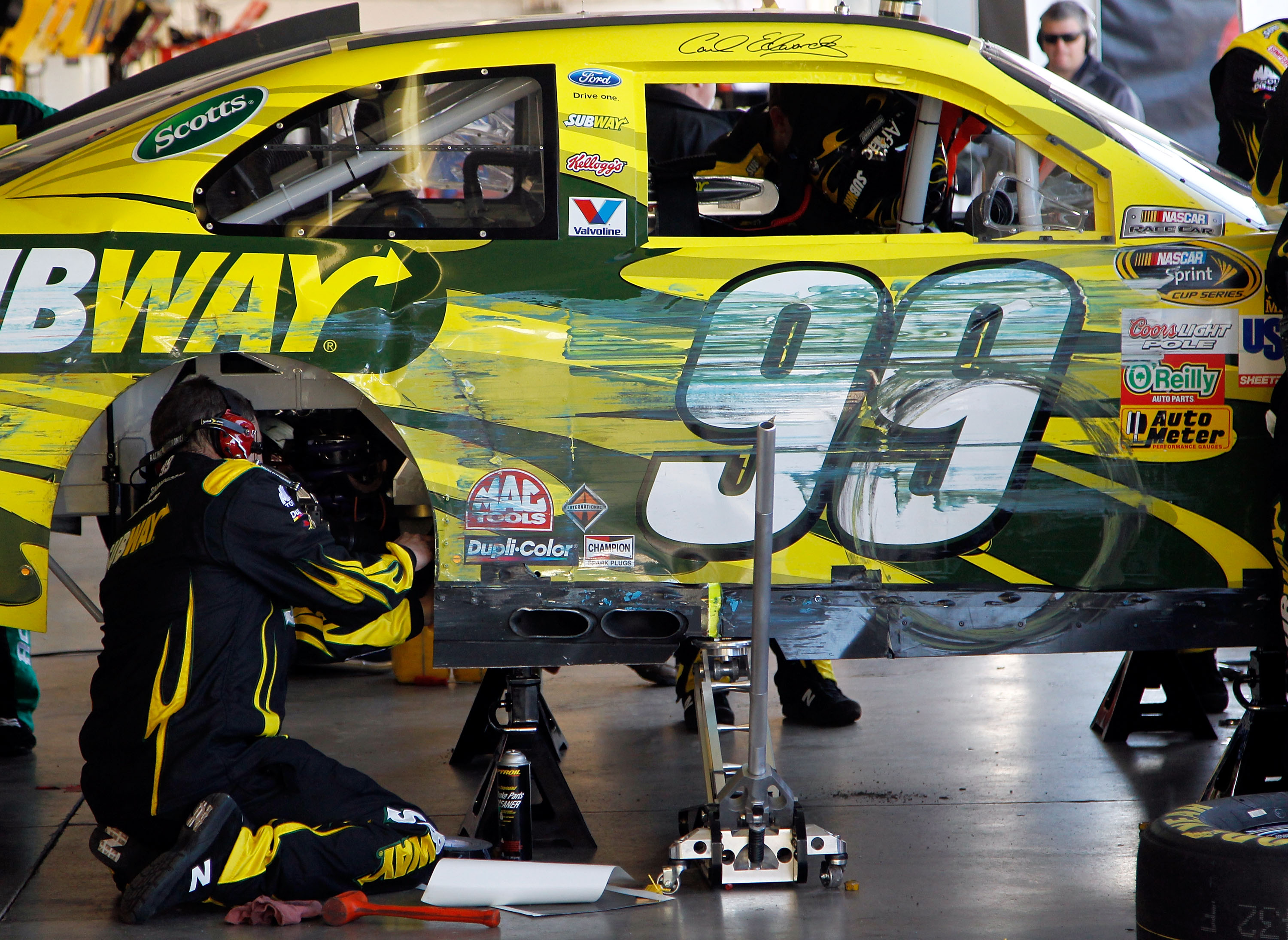 AVONDALE, AZ - FEBRUARY 27:  Crew members work on the car of Carl Edwards, driver of the #99 Subway Ford, after crashing during the NASCAR Sprint Cup Series Subway Fresh Fit 500 at Phoenix International Raceway on February 27, 2011 in Avondale, Arizona.