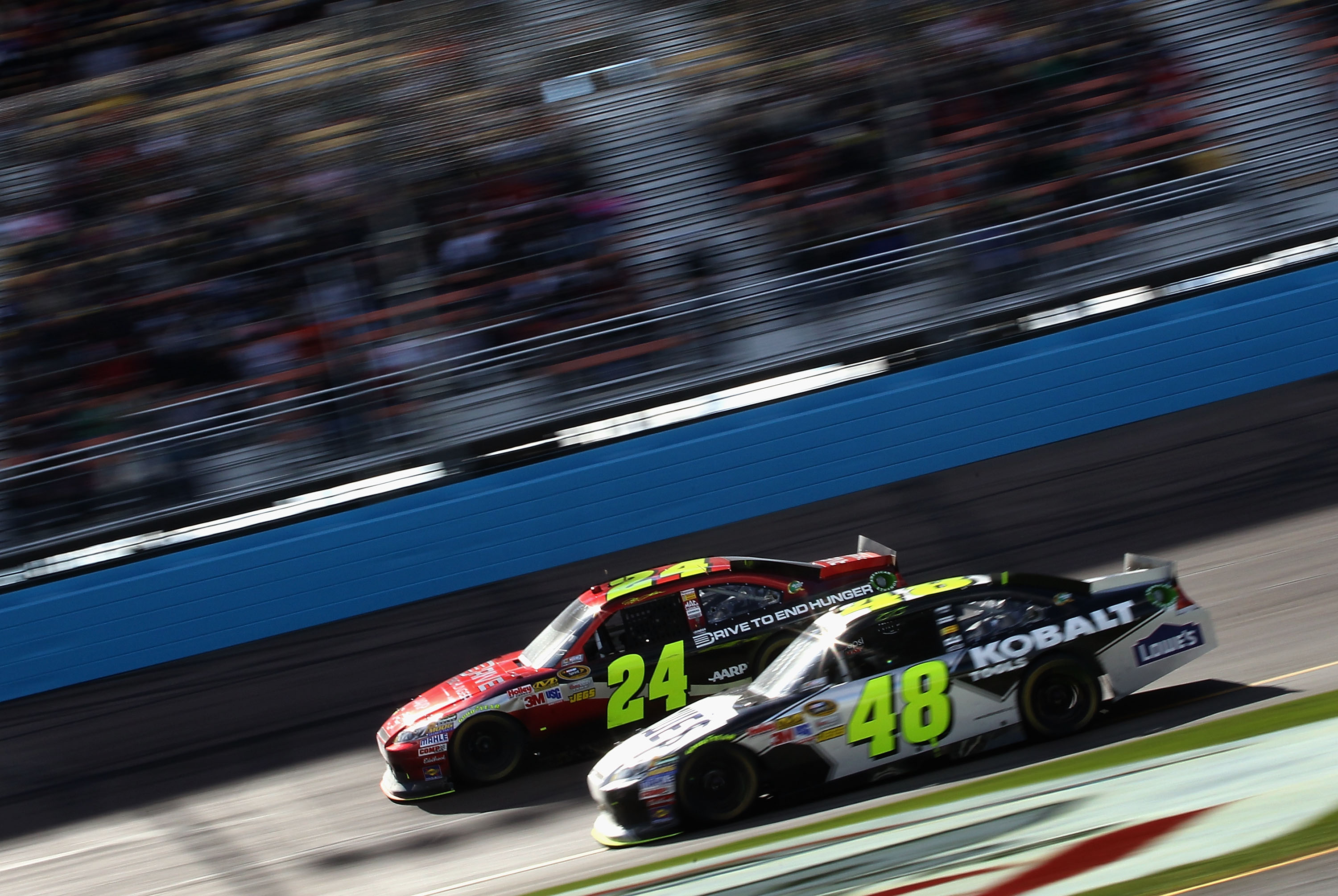 AVONDALE, AZ - FEBRUARY 27:  Jeff Gordon, driver of the #24 Drive to End Hunger Chevrolet, races Jimmie Johnson, driver of the #48 Lowe's Chevrolet, during the NASCAR Sprint Cup Series Subway Fresh Fit 500 at Phoenix International Raceway on February 27,