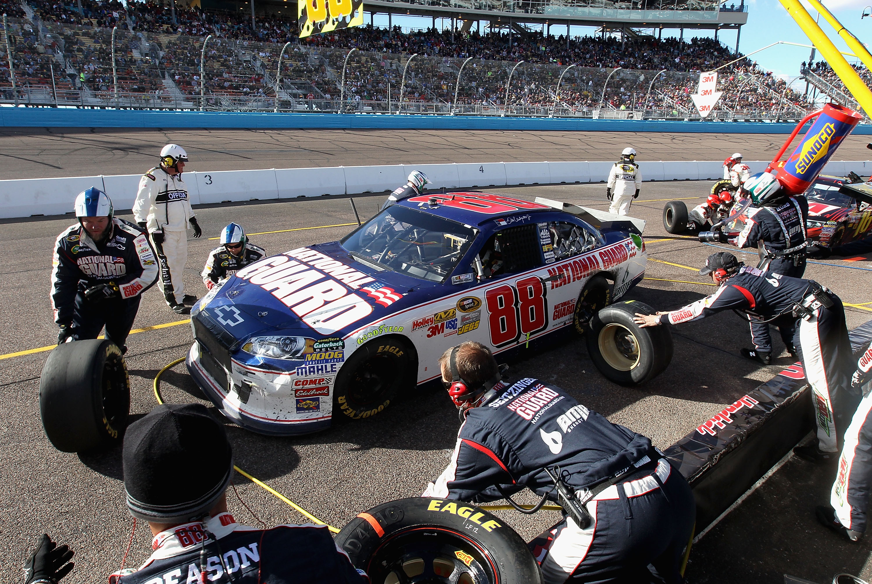 AVONDALE, AZ - FEBRUARY 27:  Dale Earnhardt Jr., driver of the #88 National Guard/AMP Energy Chevrolet, makes a pit stop during the NASCAR Sprint Cup Series Subway Fresh Fit 500 at Phoenix International Raceway on February 27, 2011 in Avondale, Arizona.