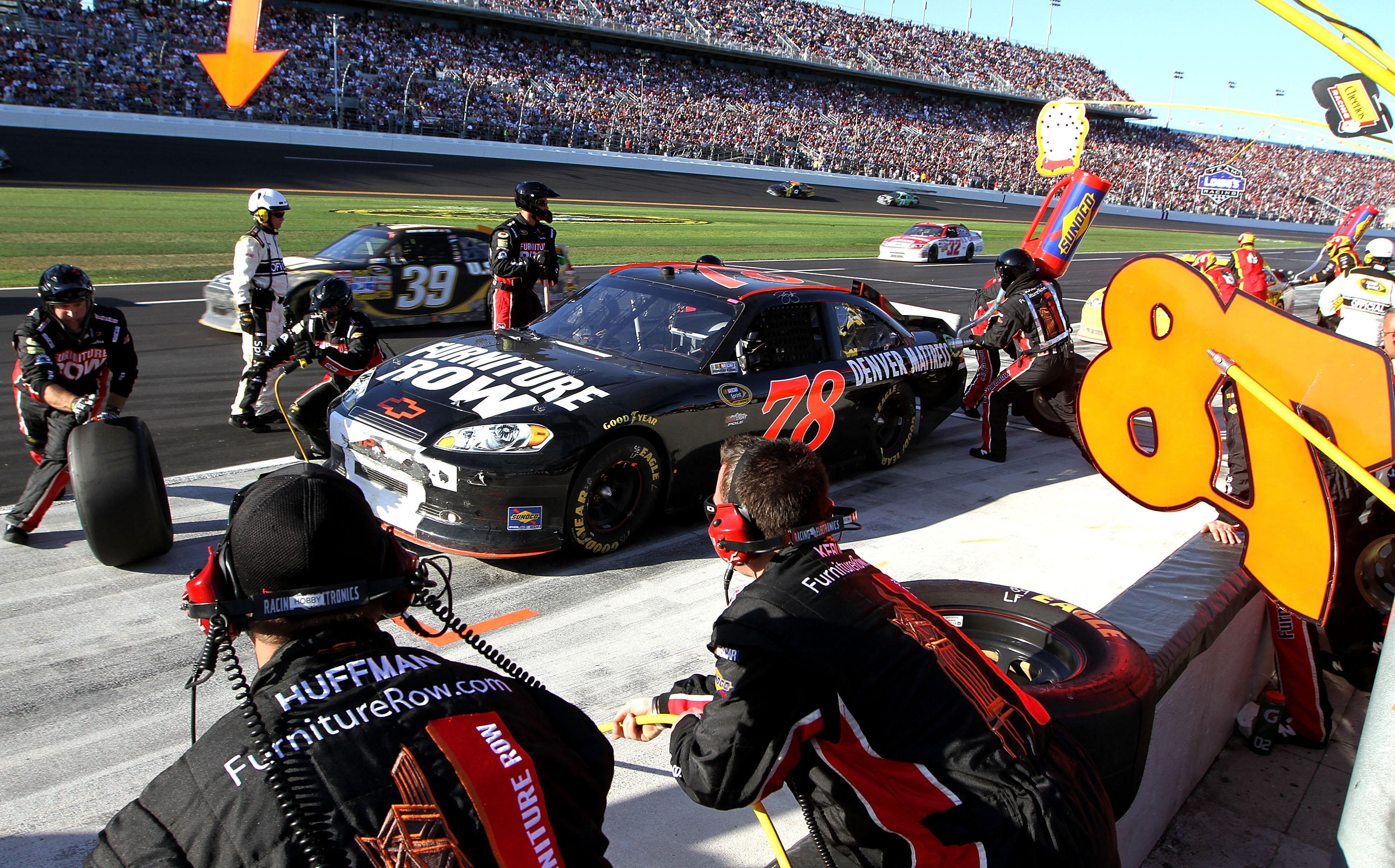 DAYTONA BEACH, FL - FEBRUARY 20:  Regan Smith pits the #78 Furniture Row Racing Chevrolet during the NASCAR Sprint Cup Series Daytona 500 at Daytona International Speedway on February 20, 2011 in Daytona Beach, Florida.  (Photo by Jerry Markland/Getty Ima