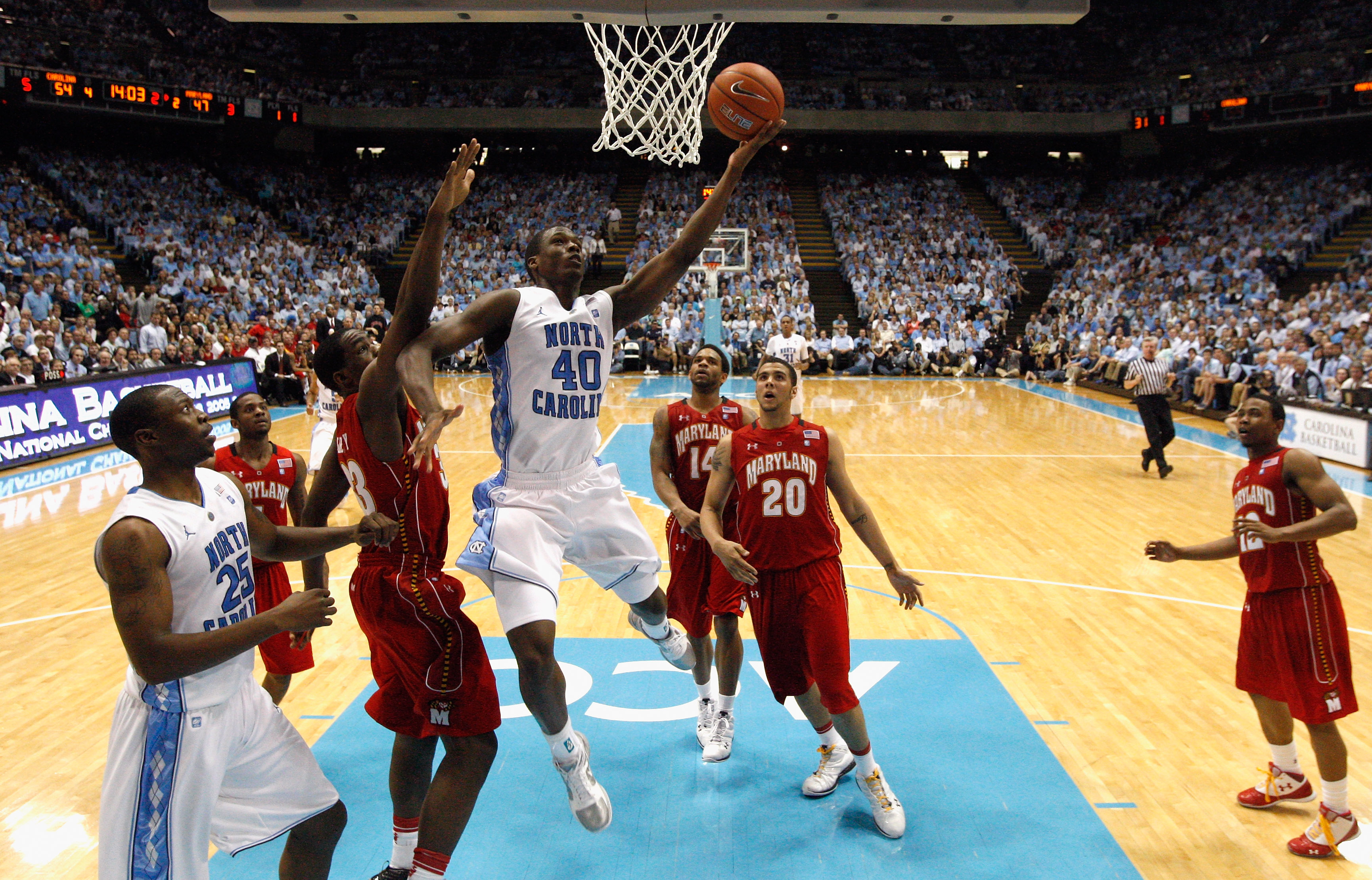 CHAPEL HILL, NC - FEBRUARY 27:  Harrison Barnes #40 of the North Carolina Tar Heels drives to the basket on Dino Gregory #33 of the Maryland Terrapins during their game at the Dean E. Smith Center on February 27, 2011 in Chapel Hill, North Carolina.  (Pho