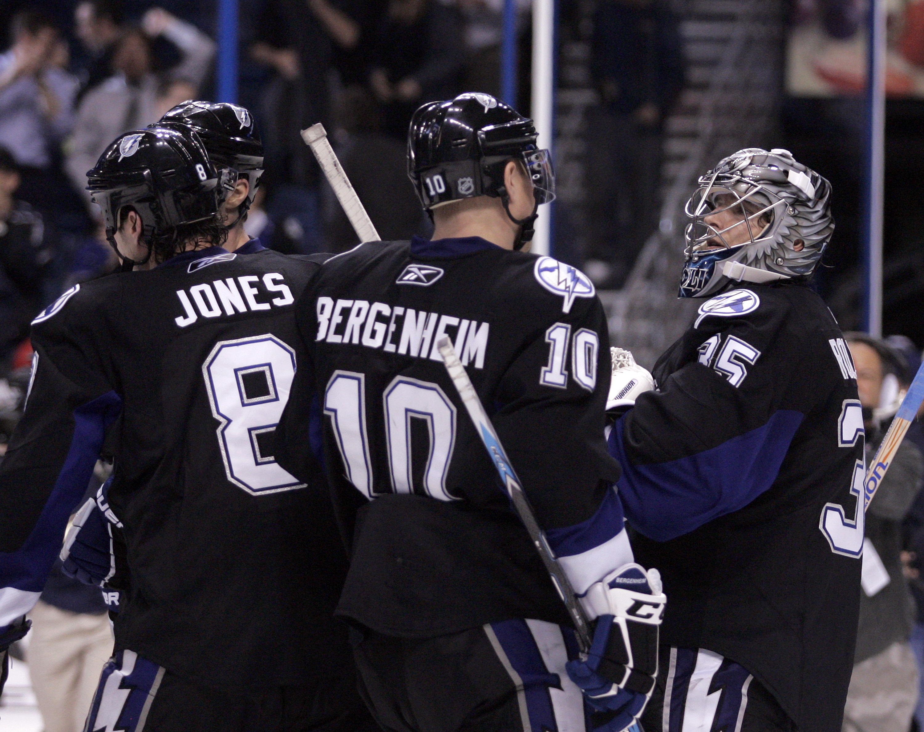 TAMPA, FL - JANUARY 25:  Dwayne Roloson #35 of the Tampa Bay Lightning is congratulated by teammate Sean Bergenheim #10 after shutting out the Toronto Maple Leafs at St. Pete Times Forum on January 25, 2011 in Tampa, Florida.  The Lightning defeated the L