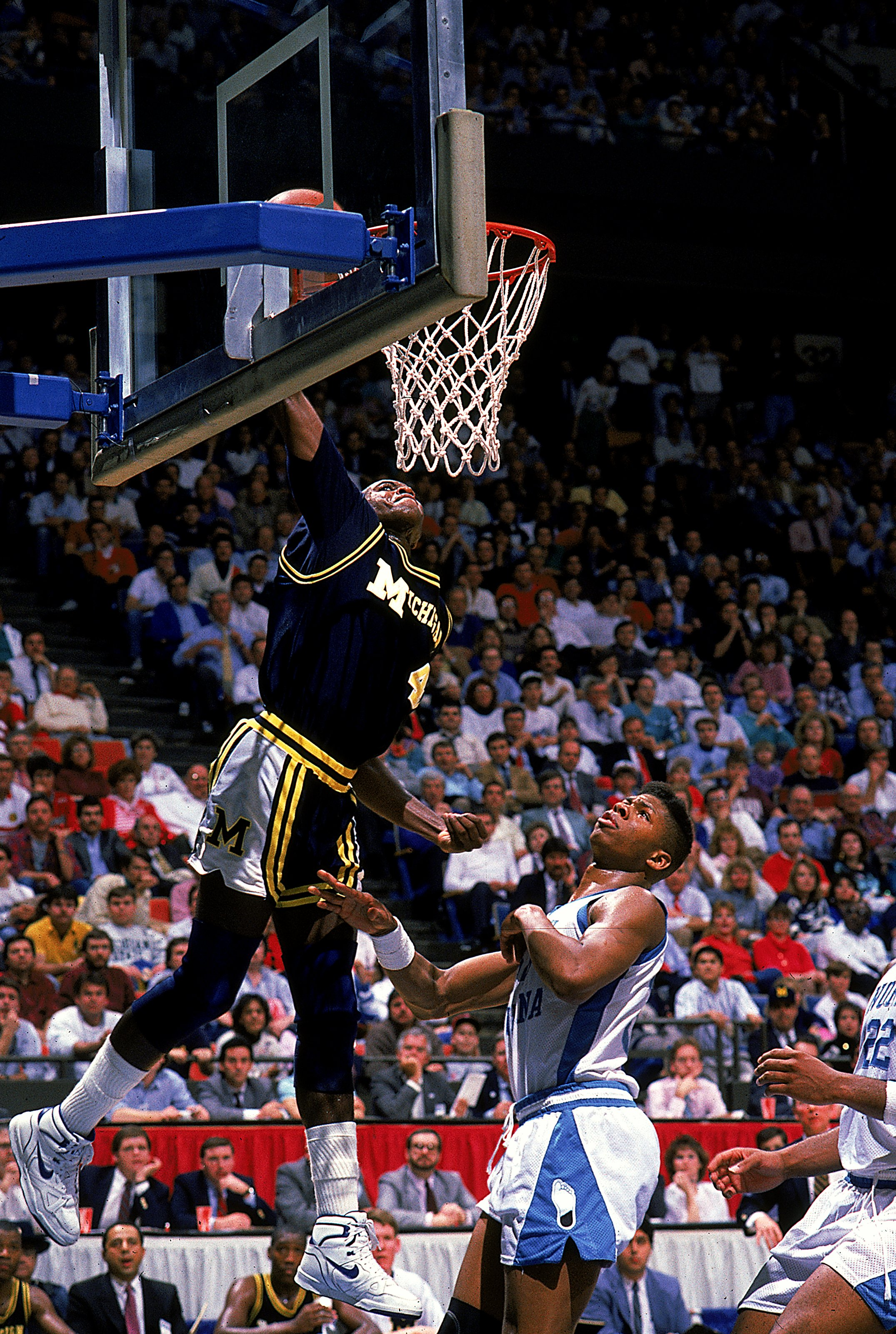 Glen Rice #4 of the University of Michigan Wolverines makes a slam dunk during the game against the North Carolina Tar Heels.