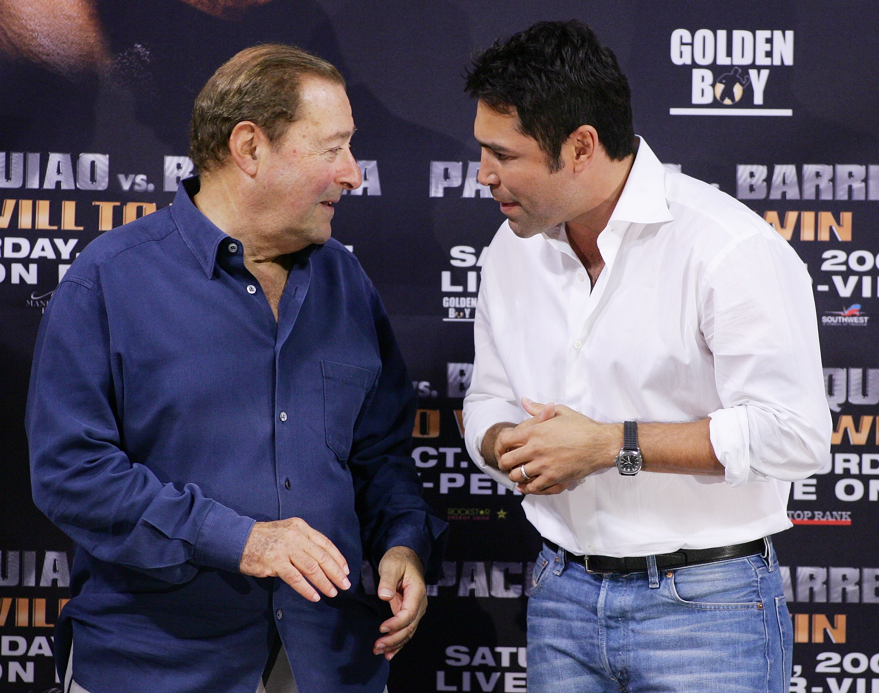 LAS VEGAS - OCTOBER 05:  Boxing promoter Bob Arum (L) and boxer and president of Golden Boy Promotions Oscar De La Hoya speak at the official weigh-in for boxers Manny Pacquiao and Marco Antonio Barrera at the Mandalay Bay Events Center October 5, 2007 in