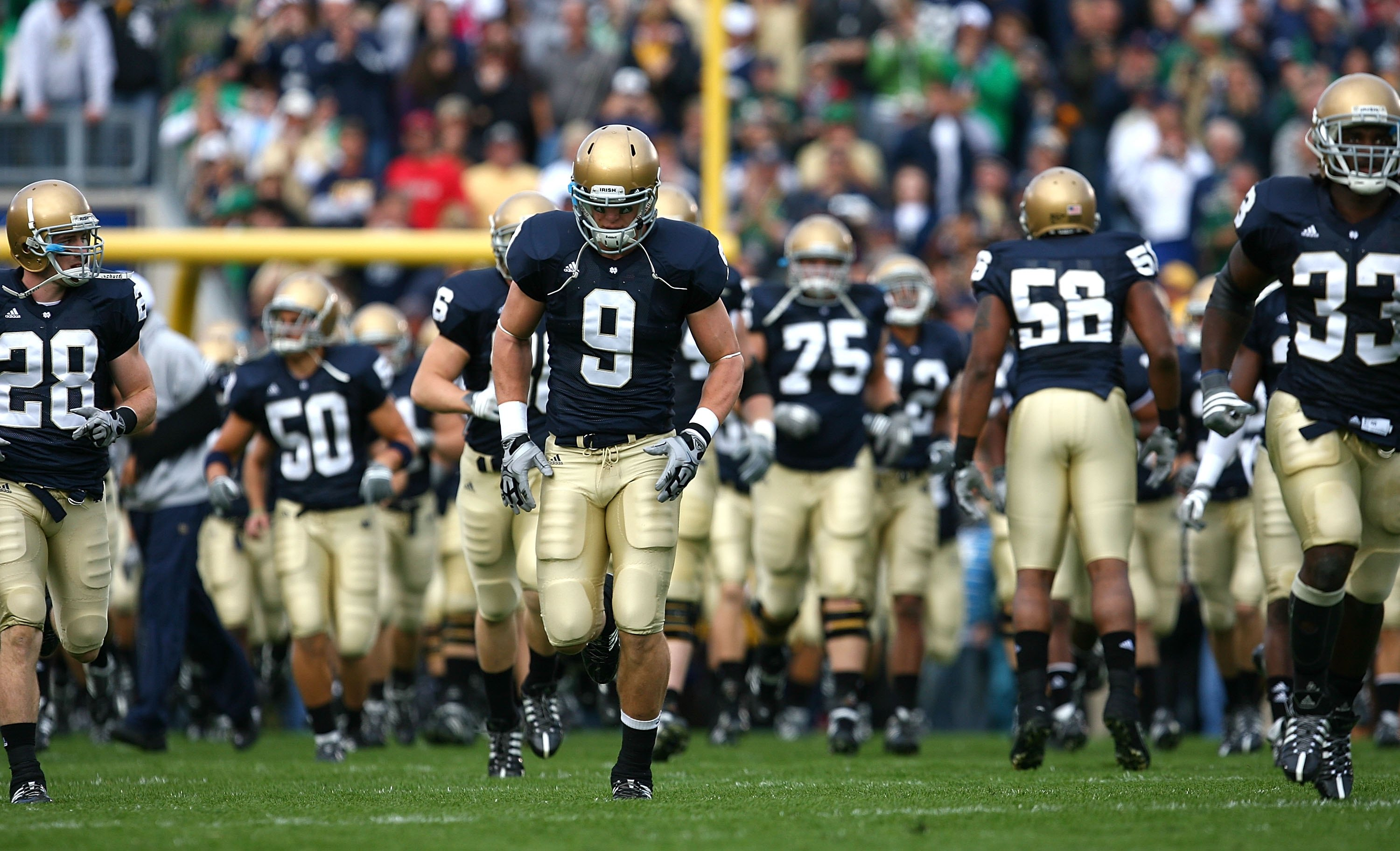 SOUTH BEND, IN - OCTOBER 03: Kyle Rudolph #9 of the Notre Dame Fighting Irish runs onto the field with teammates before a game against the Washington Huskies on October 3, 2009 at Notre Dame Stadium in South Bend, Indiana. Notre Dame defeated Washington 3