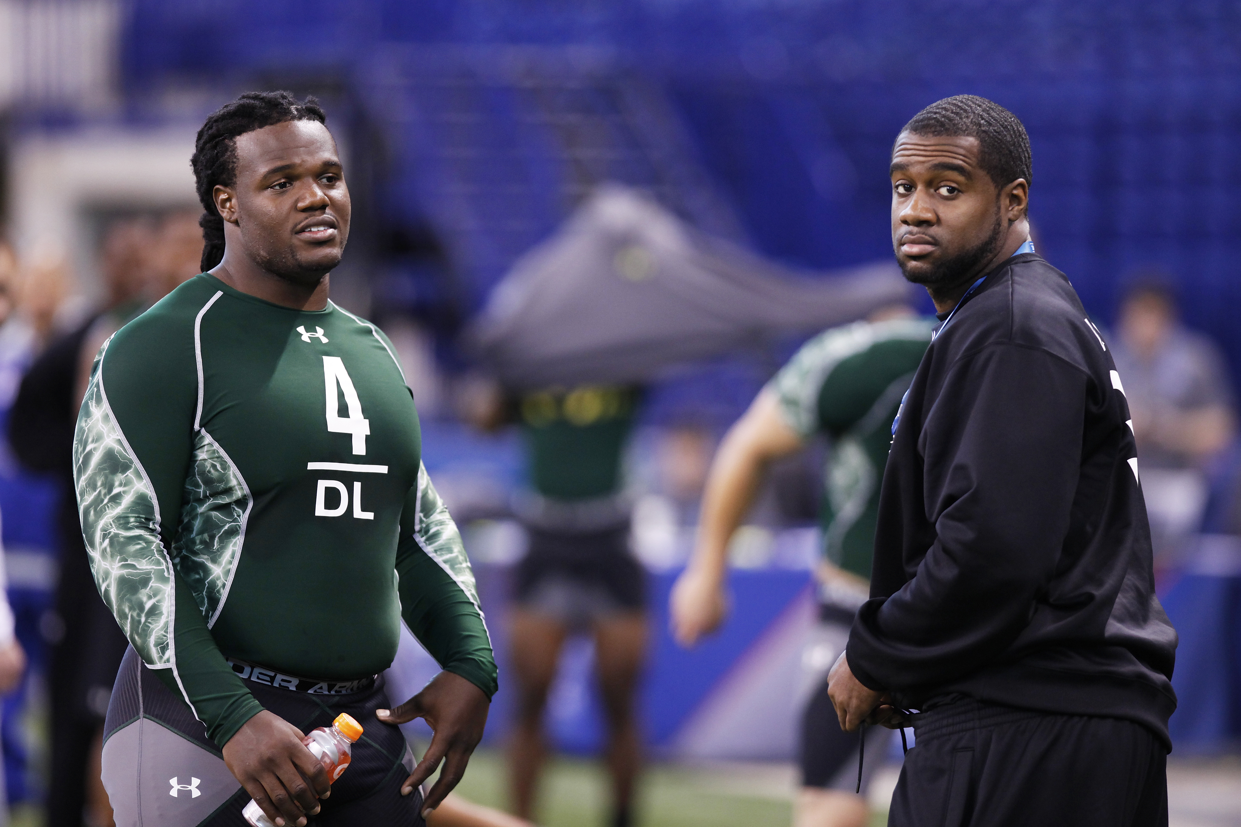 INDIANAPOLIS, IN - FEBRUARY 28: Former North Carolina teammates Marvin Austin (L) and Bruce Carter look on during the 2011 NFL Scouting Combine at Lucas Oil Stadium on February 28, 2011 in Indianapolis, Indiana. (Photo by Joe Robbins/Getty Images)
