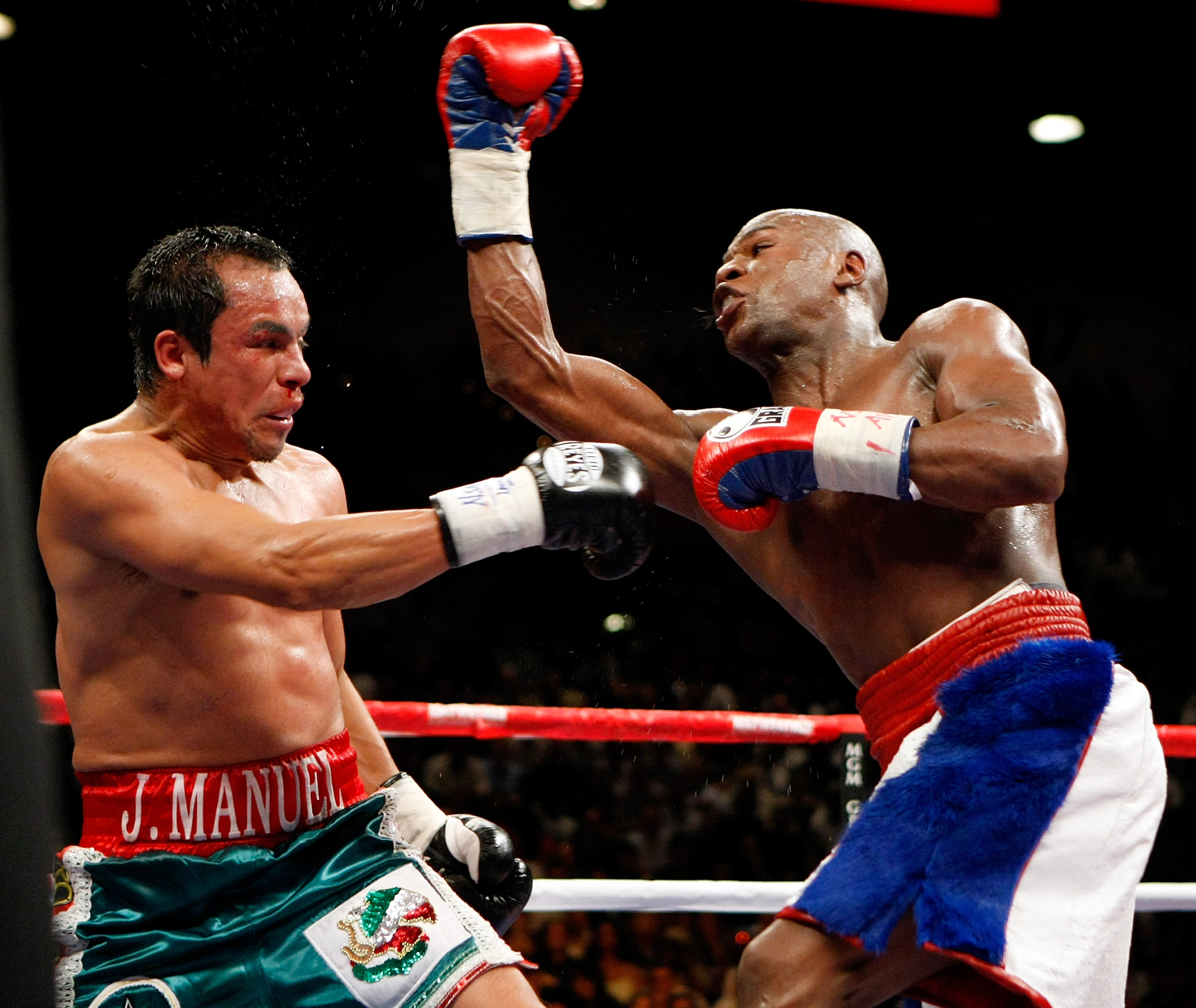 LAS VEGAS - SEPTEMBER 19:  Floyd Mayweather Jr. (R) throws a punch at Juan Manuel Marquez in the sixth round of their fight at the MGM Grand Garden Arena September 19, 2009 in Las Vegas, Nevada. Mayweather won by unanimous decision.  (Photo by Ethan Mille