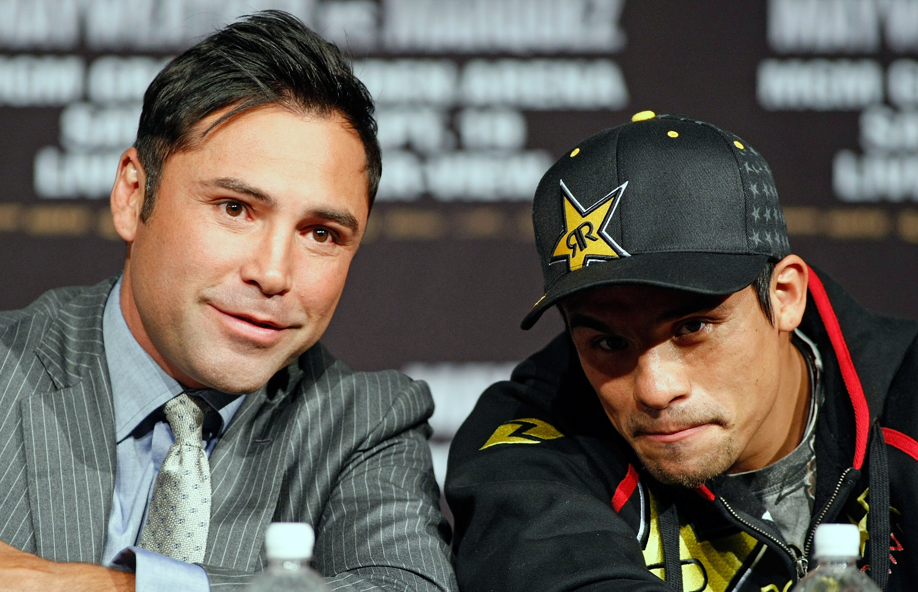 LAS VEGAS - SEPTEMBER 16:  Boxing promoter Oscar De La Hoya (L) and Juan Manuel Marquez appear during the final news conference for Marquez' bout against Floyd Mayweather Jr. at the MGM Grand Hotel/Casino September 16, 2009 in Las Vegas, Nevada. Marquez a