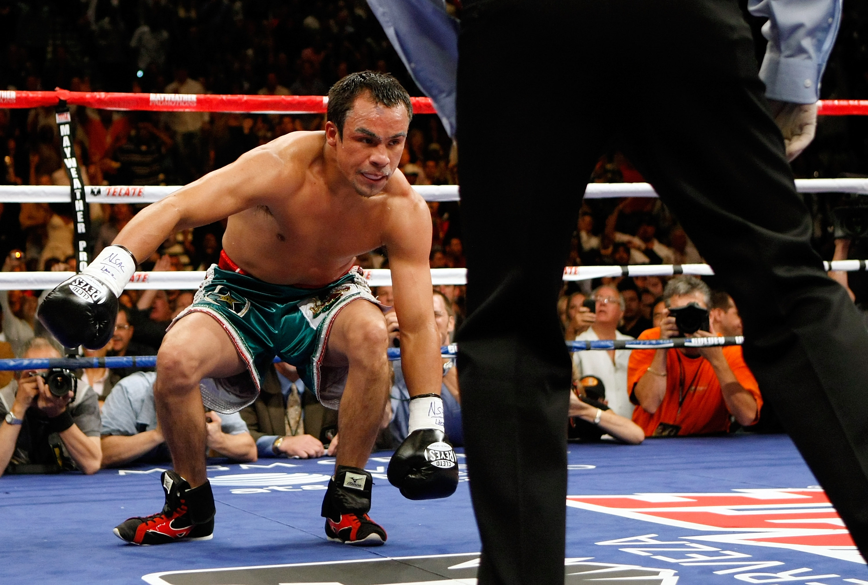 LAS VEGAS - SEPTEMBER 19:  Juan Manuel Marquez gets up off the canvas after he was knocked down by Floyd Mayweather Jr. in the second round of their fight at the MGM Grand Garden Arena September 19, 2009 in Las Vegas, Nevada. Mayweather won by unanimous d