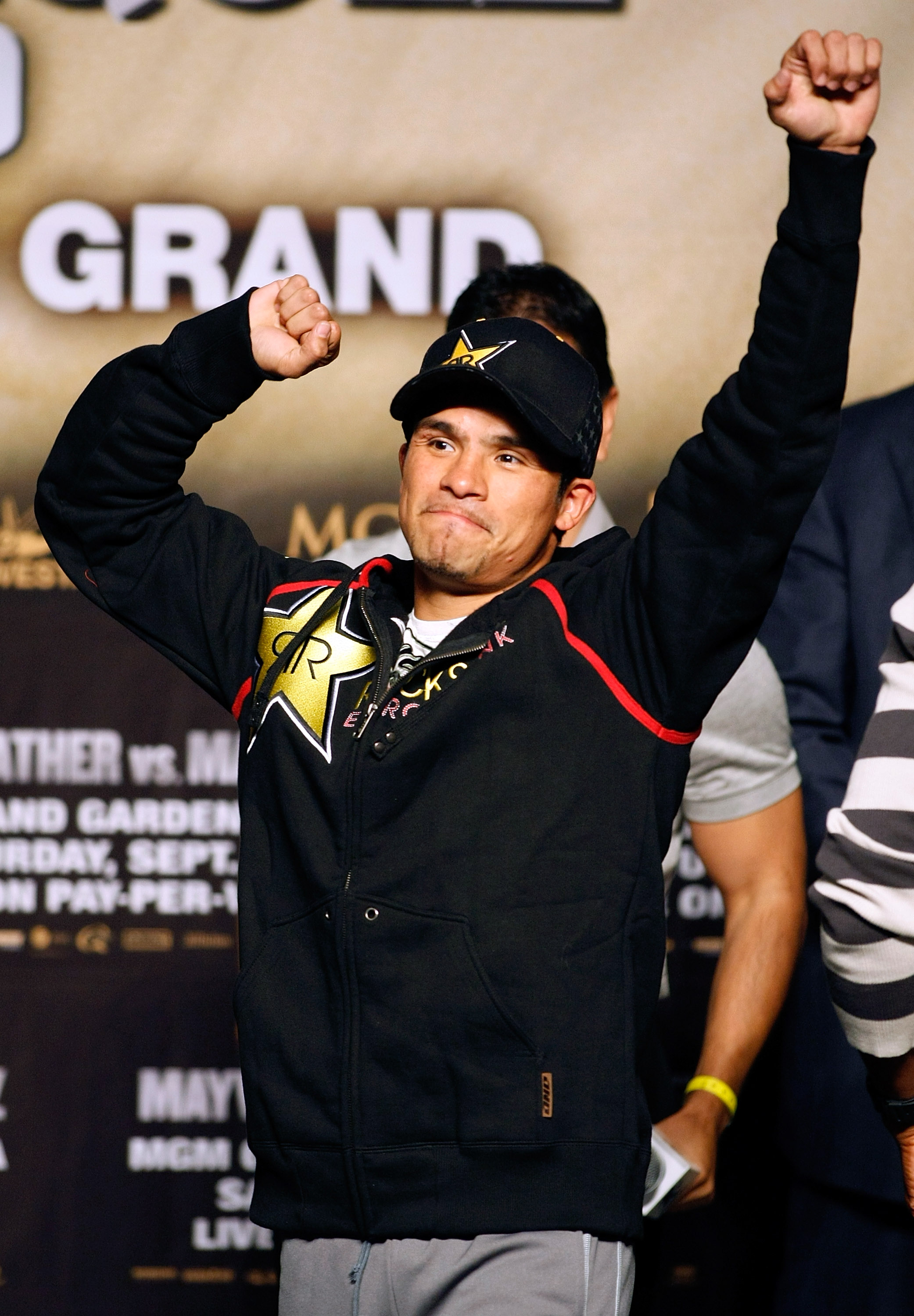 LAS VEGAS - SEPTEMBER 18:  Boxer Juan Manuel Marquez gestures during his official weigh-in for his fight with Floyd Mayweather Jr. at the MGM Grand Garden Arena September 18, 2009 in Las Vegas, Nevada. The two will fight at the MGM on September 19.  (Phot