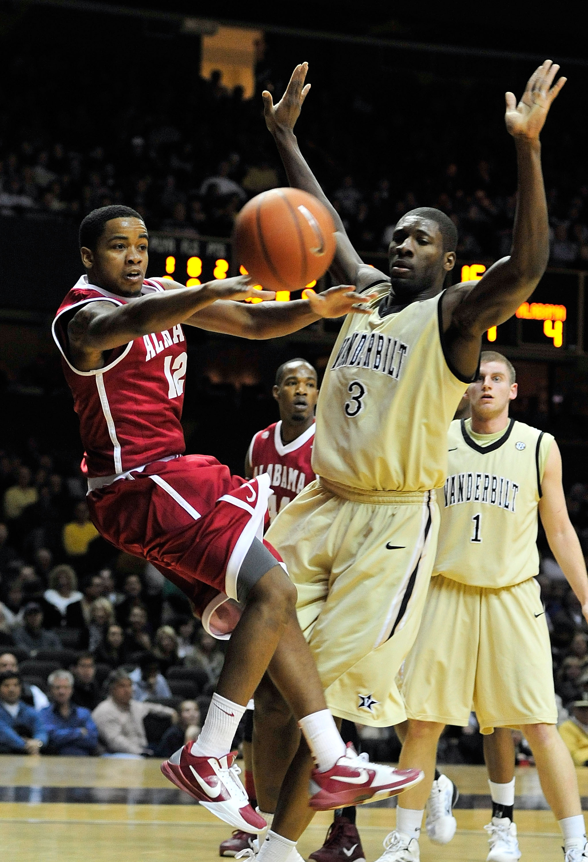 NASHVILLE, TN - FEBRUARY 10:  Trevor Releford #13 of the Alabama Crimson Tide drives against Festus Ezeli #3 of the Vanderbilt Commodores at Memorial Gym on February 10, 2011 in Nashville, Tennessee.  (Photo by Grant Halverson/Getty Images)