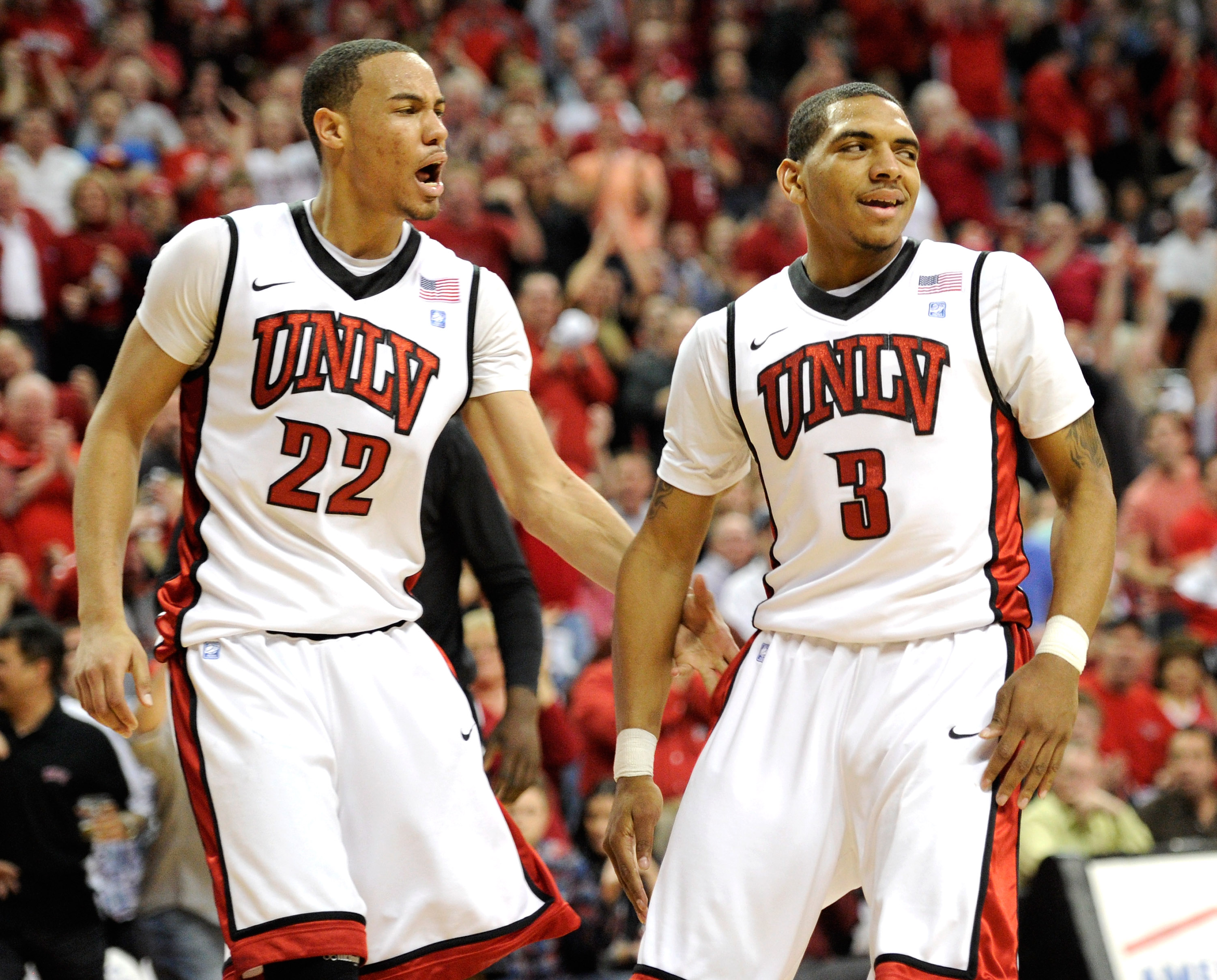 LAS VEGAS, NV - FEBRUARY 12:  Chace Stanback #22 and Anthony Marshall #3 of the UNLV Rebels react after Marshall took an offensive charge for a San Diego State Aztecs foul during their game at the Thomas & Mack Center February 12, 2011 in Las Vegas, Nevad