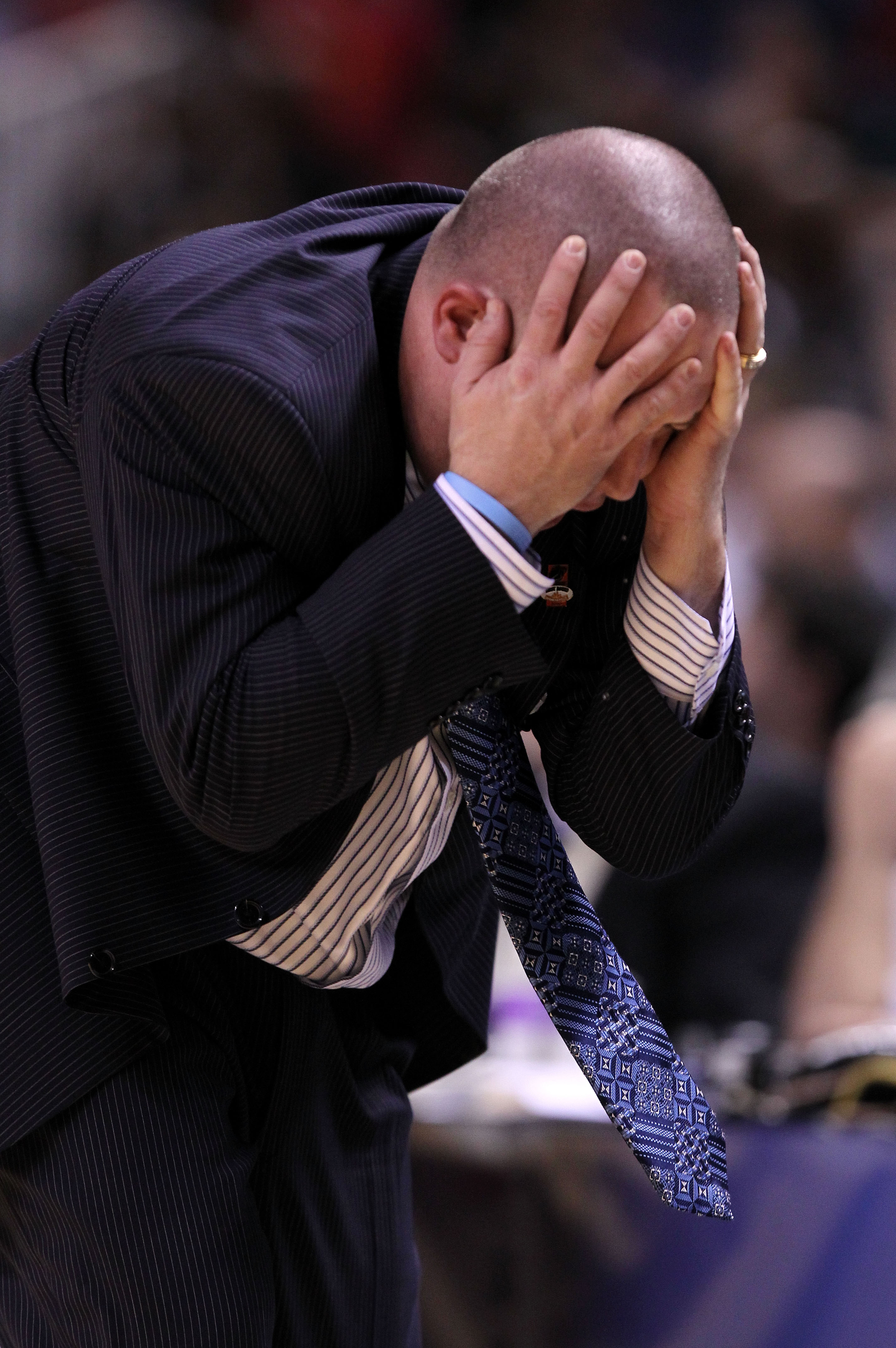 SAN JOSE, CA - MARCH 18:  Head coach Buzz Williams of the Marquette Golden Eagles reacts to a play during their game against the Washington Huskies in the first round of the 2010 NCAA men's basketball tournament at HP Pavilion on March 18, 2010 in San Jos