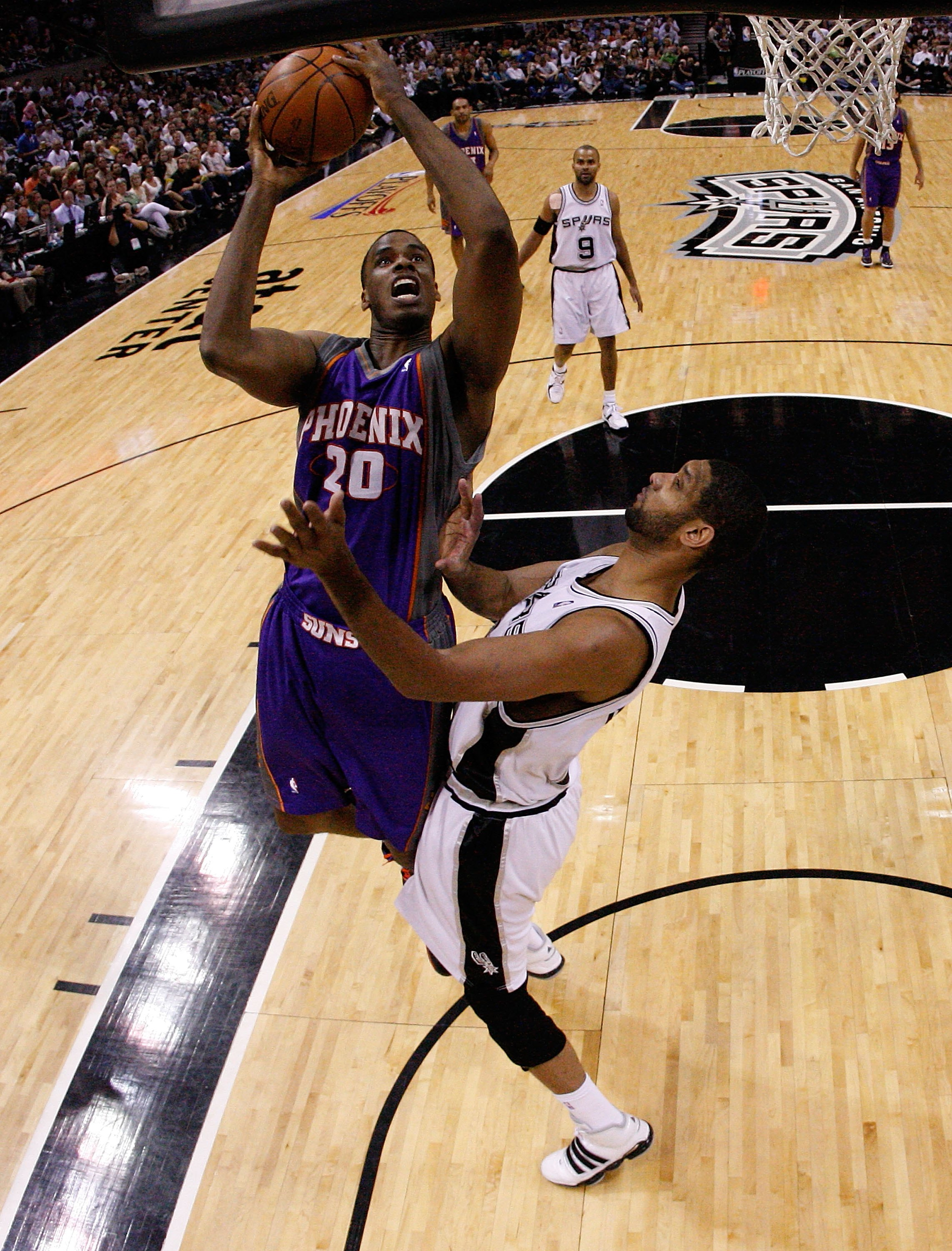 SAN ANTONIO - MAY 09:  Forward Dwayne Jones #20 of the Phoenix Suns takes a shot against Tim Duncan #21 of the San Antonio Spurs in Game Four of the Western Conference Semifinals during the 2010 NBA Playoffs at AT&T Center on May 9, 2010 in San Antonio, T