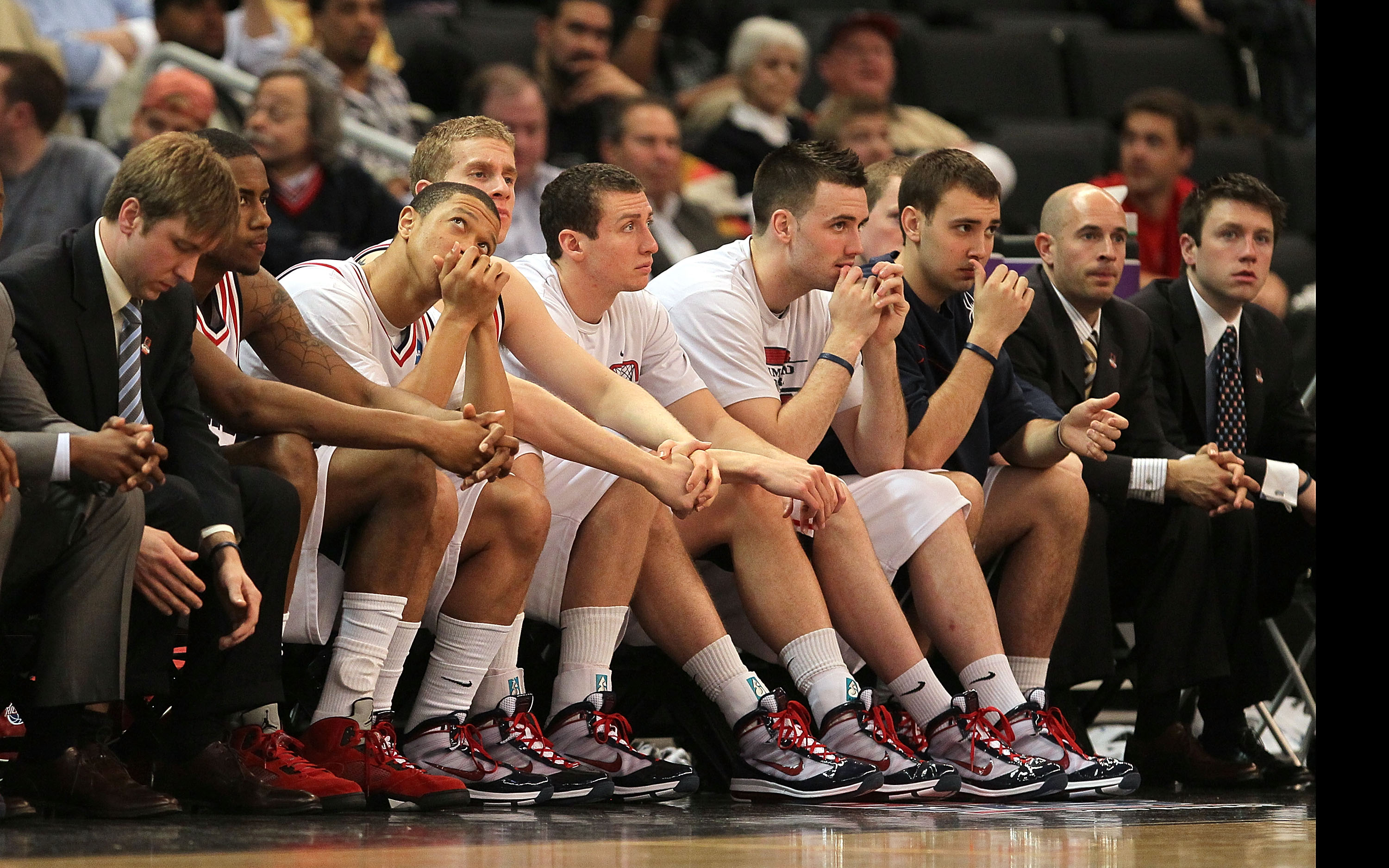 PROVIDENCE, RI - MARCH 18:  The bench of the Richmond Spiders reacts in the final moments of a 80-71 loss to the Saint Mary's Gaels during the first round of the 2010 NCAA men's basketball tournament at Dunkin' Donuts Center on March 18, 2010 in Providenc