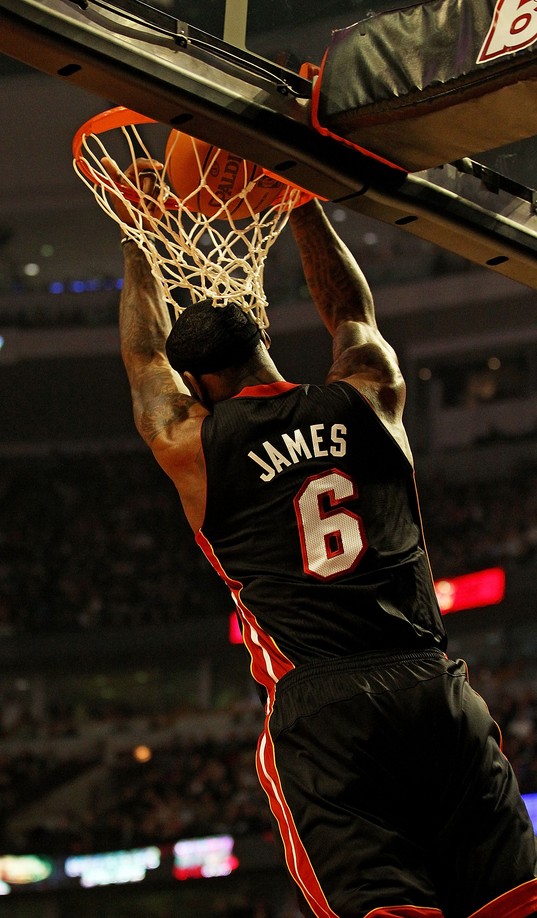 CHICAGO, IL - FEBRUARY 24: LeBron James #6 of the Miami Heat puts in a reverse dunk against the Chicago Bulls at the United Center on February 24, 2011 in Chicago, Illinois. NOTE TO USER: User expressly acknowledges and agrees that, by downloading and/or