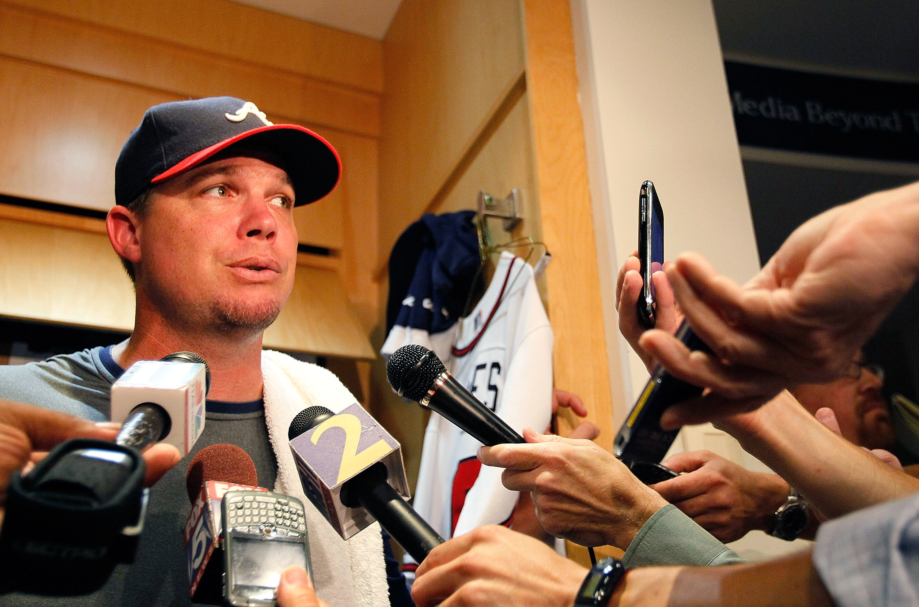 ATLANTA - JUNE 17:  Chipper Jones #10 of the Atlanta Braves holds a press conference at his locker in the team clubhouse to address his retirement before facing the Tampa Bay Rays at Turner Field on June 17, 2010 in Atlanta, Georgia.  (Photo by Kevin C. C
