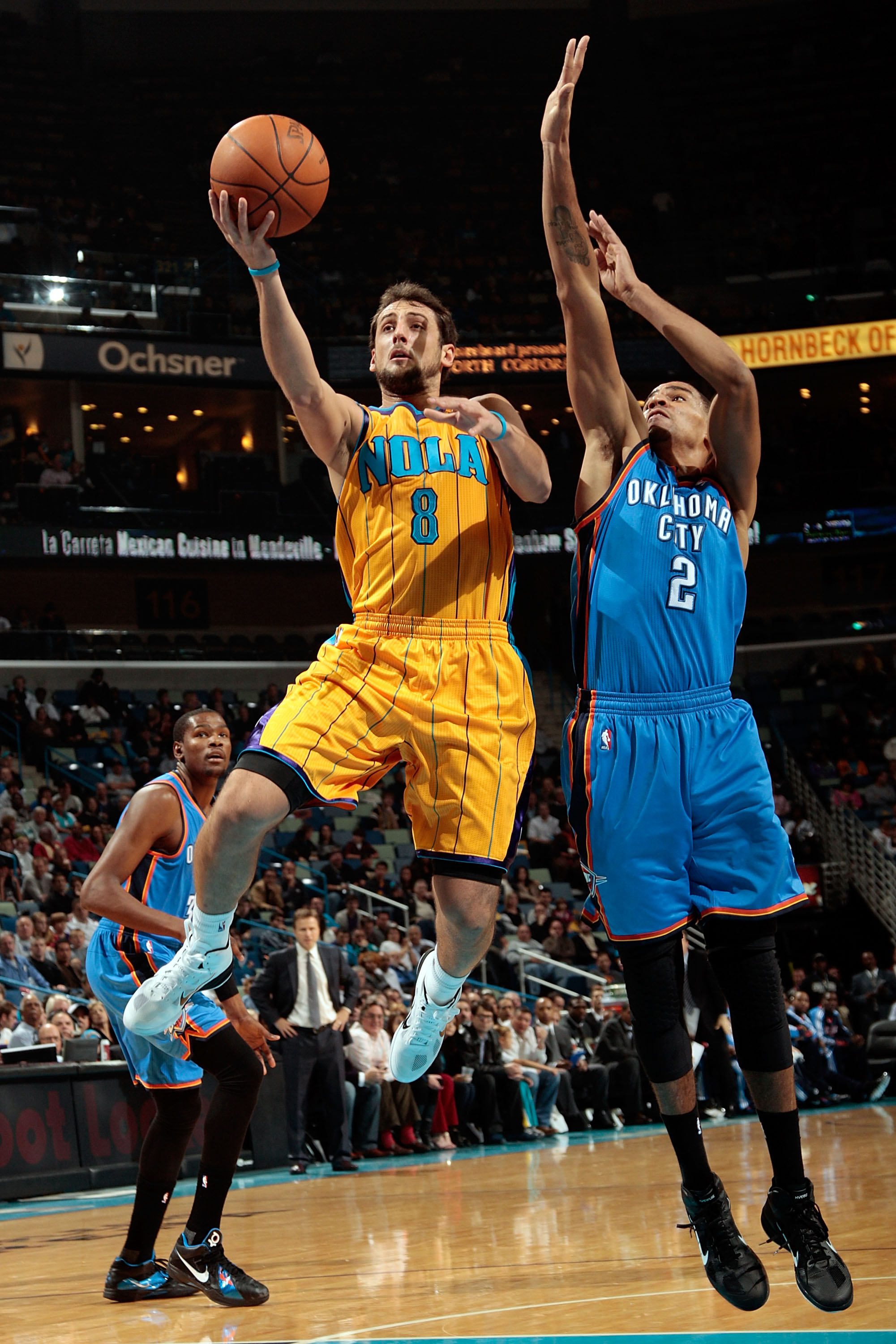 NEW ORLEANS, LA - DECEMBER 10:  Marco Belinelli #8 of the New Orleans Hornets makes a shot over Thabo Sefolosha #2 of the Oklahoma City Thunder at New Orleans Arena on December 10, 2010 in New Orleans, Louisiana.    NOTE TO USER: User expressly acknowledg