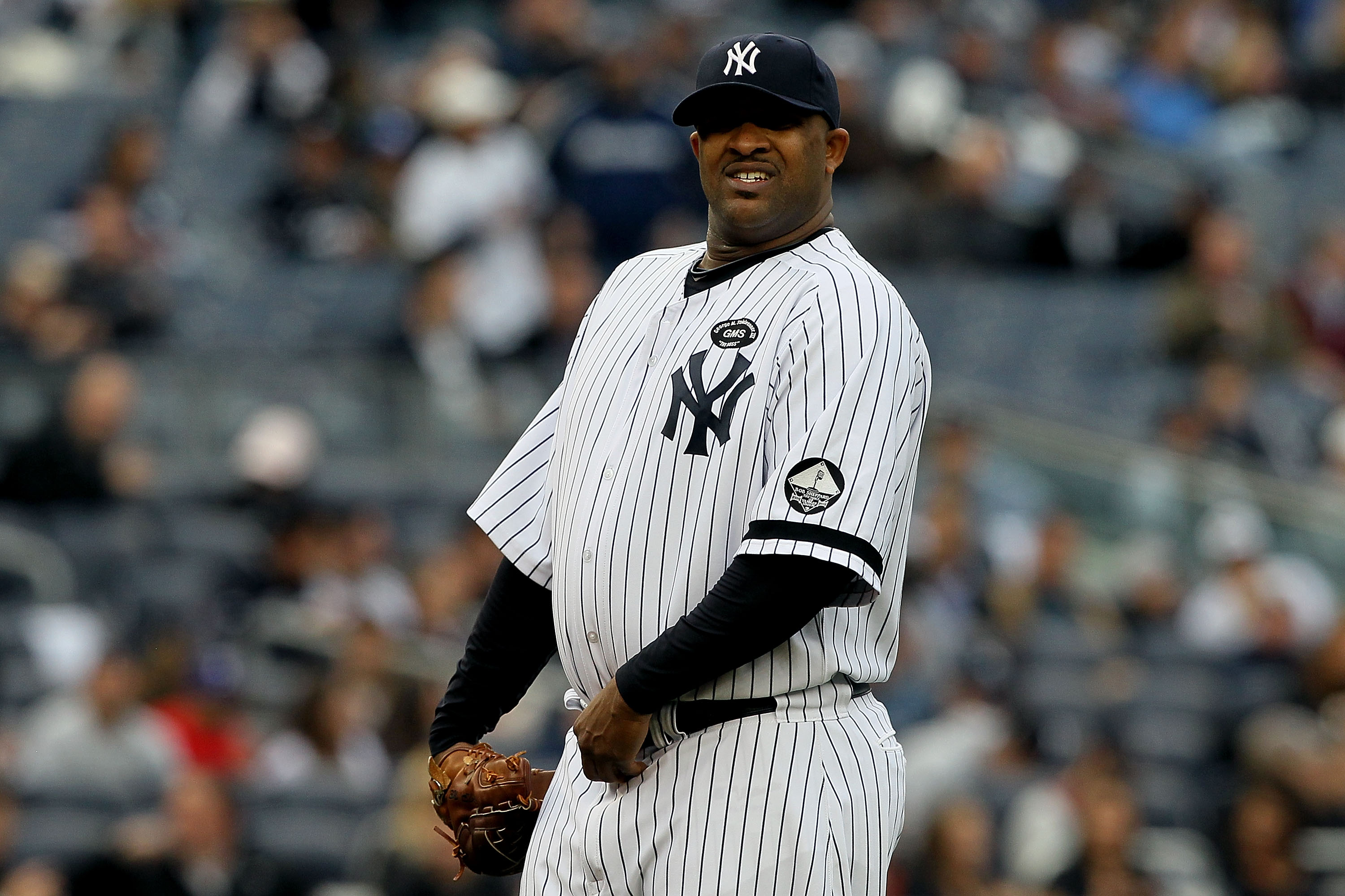 NEW YORK - OCTOBER 20:  CC Sabathia #52 of the New York Yankees reacts against the Texas Rangers in Game Five of the ALCS during the 2010 MLB Playoffs at Yankee Stadium on October 20, 2010 in the Bronx borough of New York City.  (Photo by Jim McIsaac/Gett
