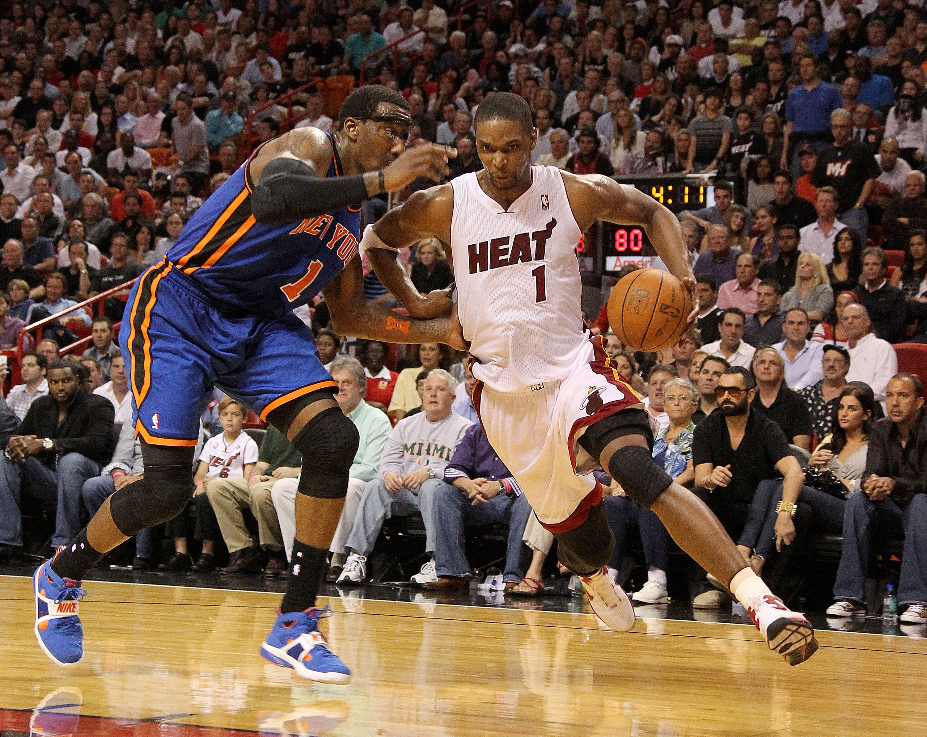 MIAMI, FL - FEBRUARY 27: Chris Bosh #1 of the Miami Heat drives past Amar'e Stoudemire #1 of the New York Knicks during a game at American Airlines Arena on February 27, 2011 in Miami, Florida. NOTE TO USER: User expressly acknowledges and agrees that, by