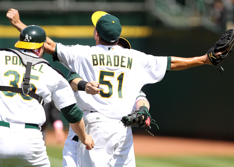 Oakland pitcher Dallas Braden celebrates with catcher Landon Powell