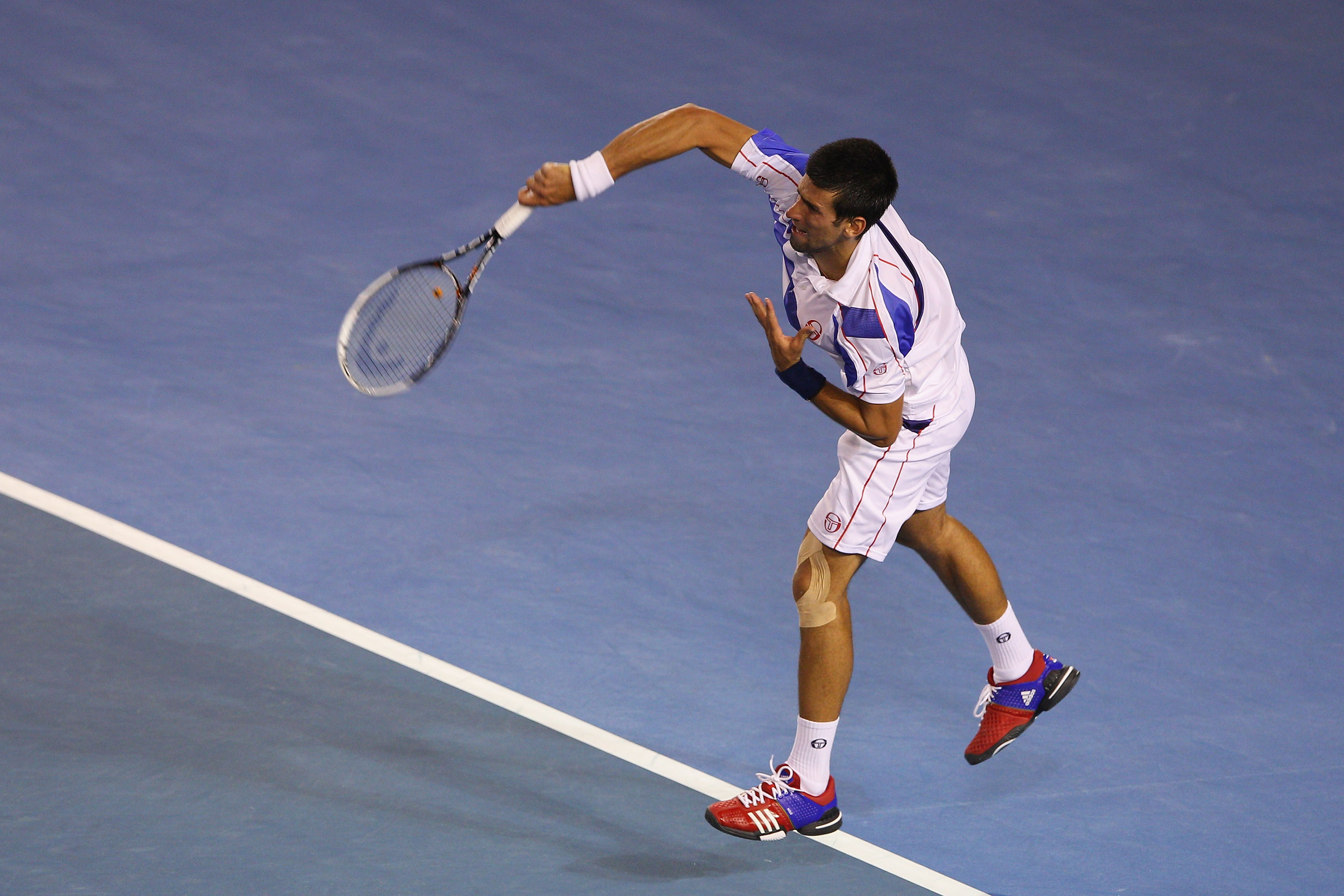 MELBOURNE, AUSTRALIA - JANUARY 30:  Novak Djokovic of Serbia serves in his men's final match against Andy Murray of Great Britain during day fourteen of the 2011 Australian Open at Melbourne Park on January 30, 2011 in Melbourne, Australia.  (Photo by Cam