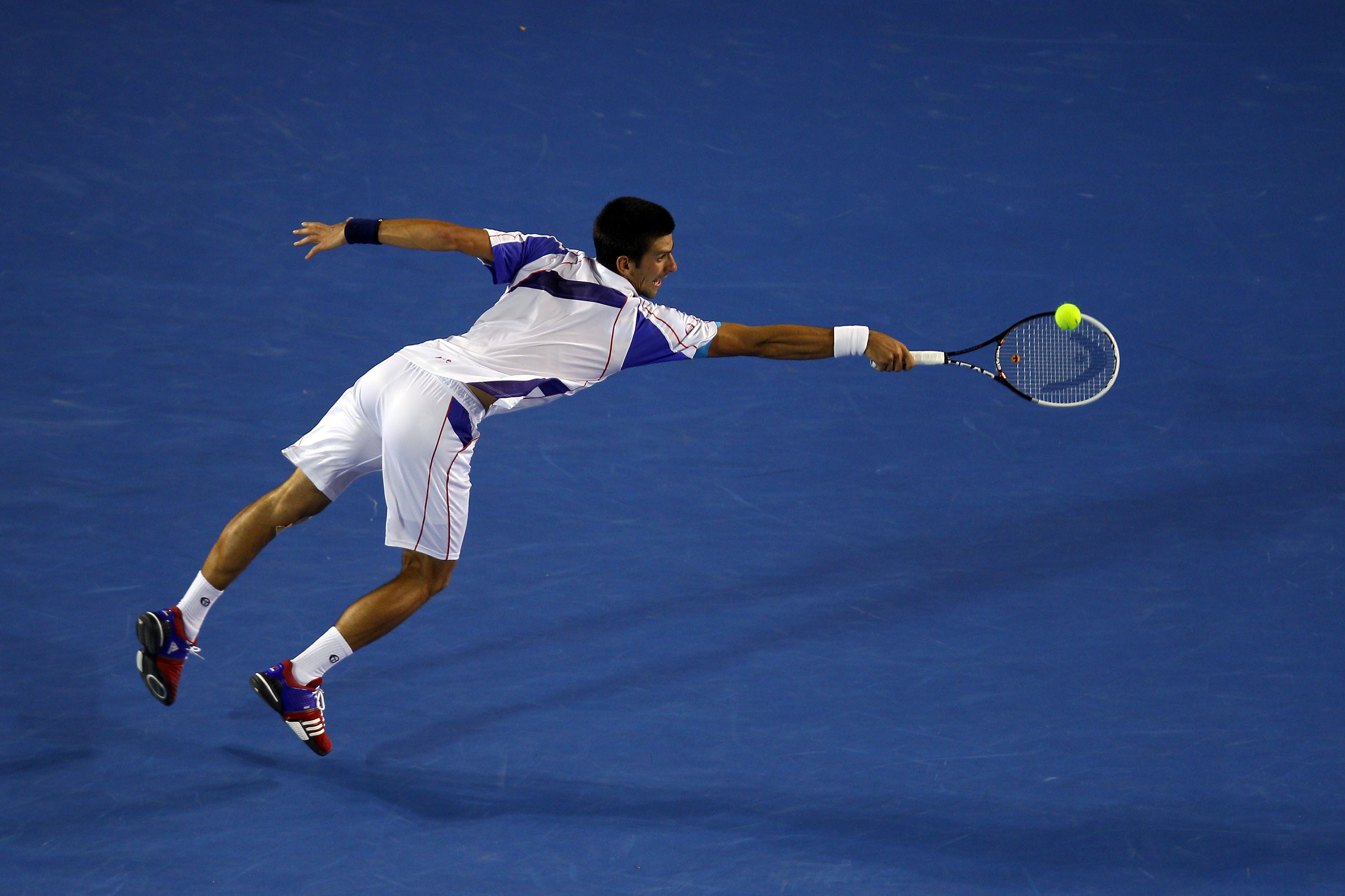MELBOURNE, AUSTRALIA - JANUARY 30:  Novak Djokovic of Serbia plays a backhand in his men's final match against Andy Murray of Great Britain during day fourteen of the 2011 Australian Open at Melbourne Park on January 30, 2011 in Melbourne, Australia.  (Ph