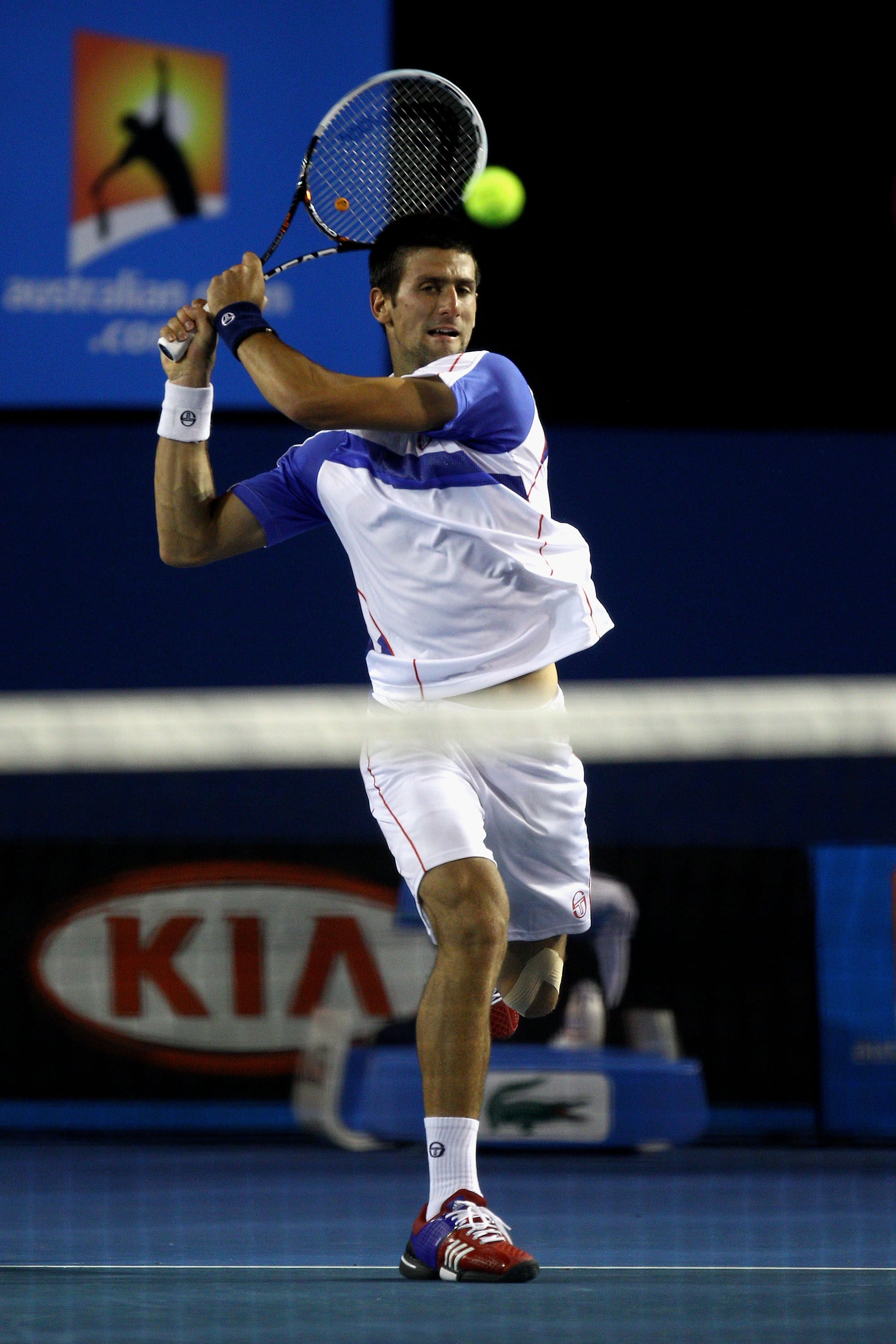 MELBOURNE, AUSTRALIA - JANUARY 30:  Novak Djokovic of Serbia plays a forehand in his men's final match against Andy Murray of Great Britain during day fourteen of the 2011 Australian Open at Melbourne Park on January 30, 2011 in Melbourne, Australia.  (Ph