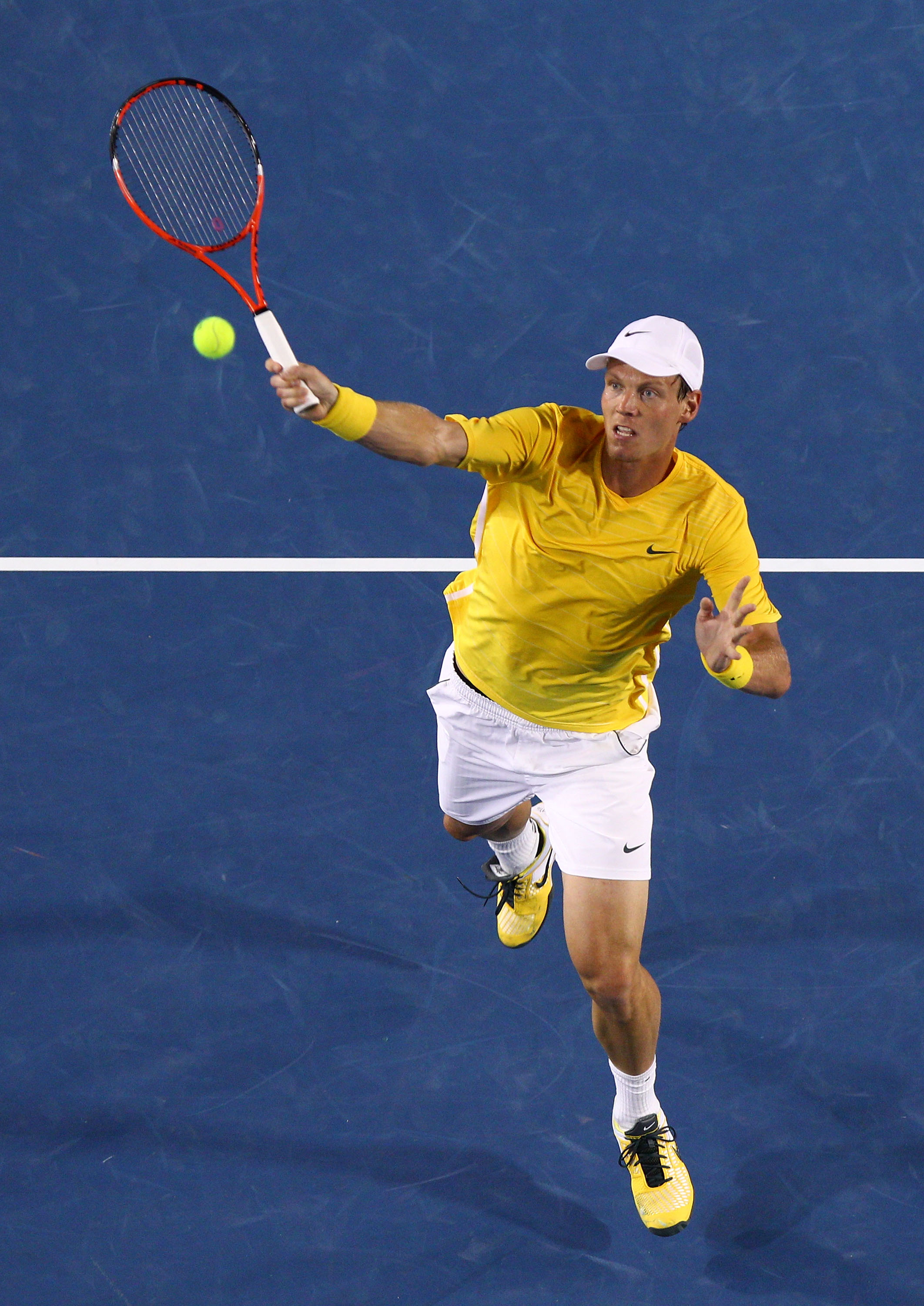 MELBOURNE, AUSTRALIA - JANUARY 25:  Tomas Berdych of the Czech Republic plays a forehand in his quarterfinal match against Novak Djokovic of Serbia during day nine of the 2011 Australian Open at Melbourne Park on January 25, 2011 in Melbourne, Australia.